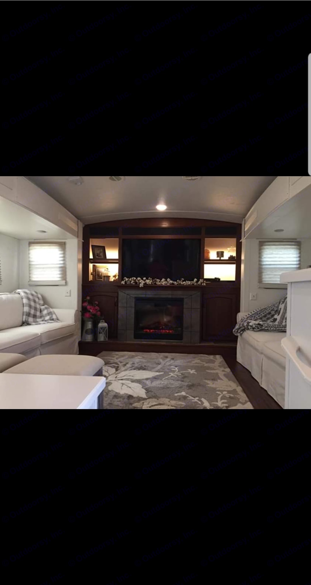 Homey living room space with 6' long brand new couches. Keystone Montana 2014