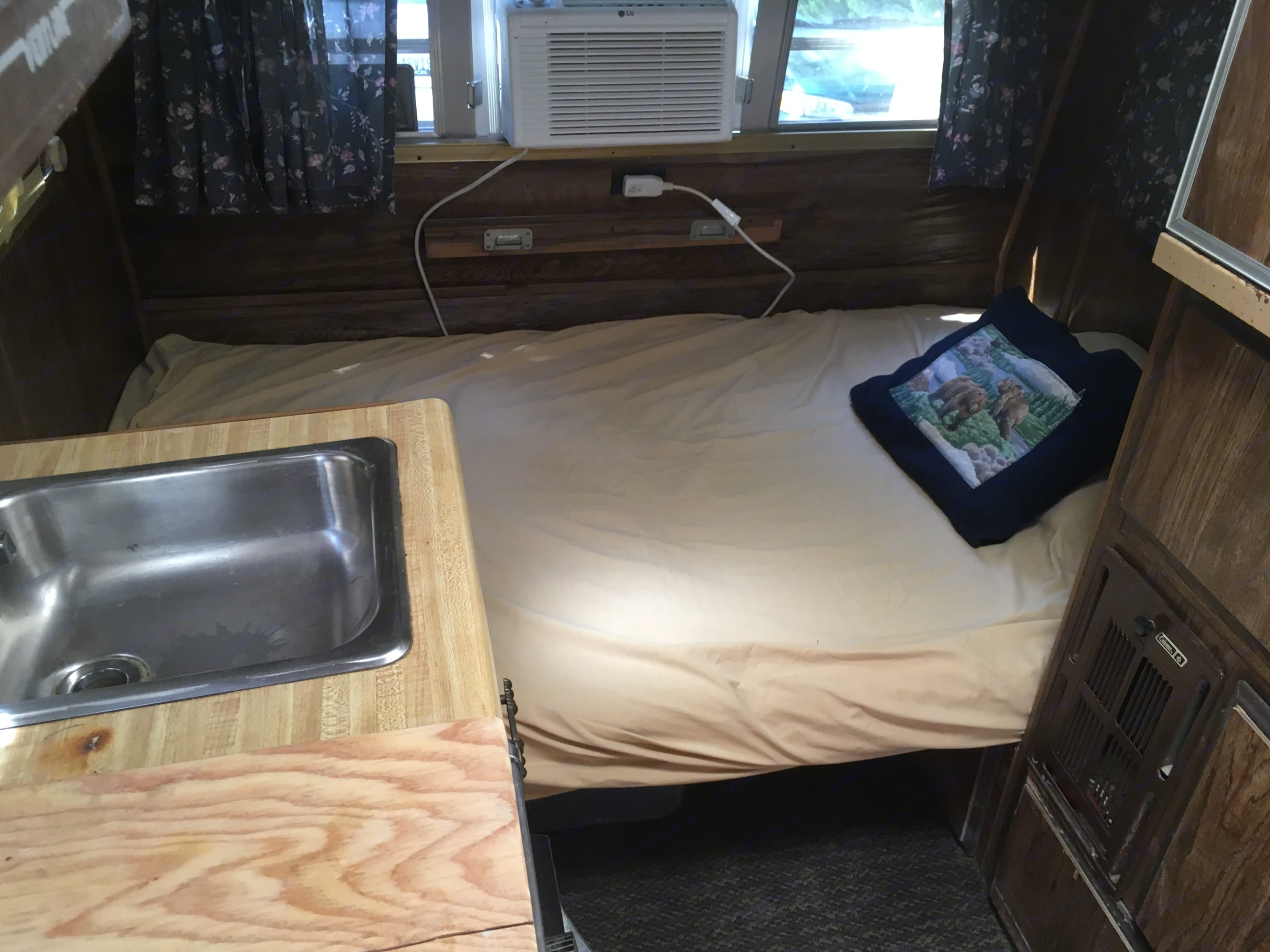 """Double/full bed (measures 4' wide x 6'6"""" long) - with optional A/C unit shown. Shasta Other 1979"""