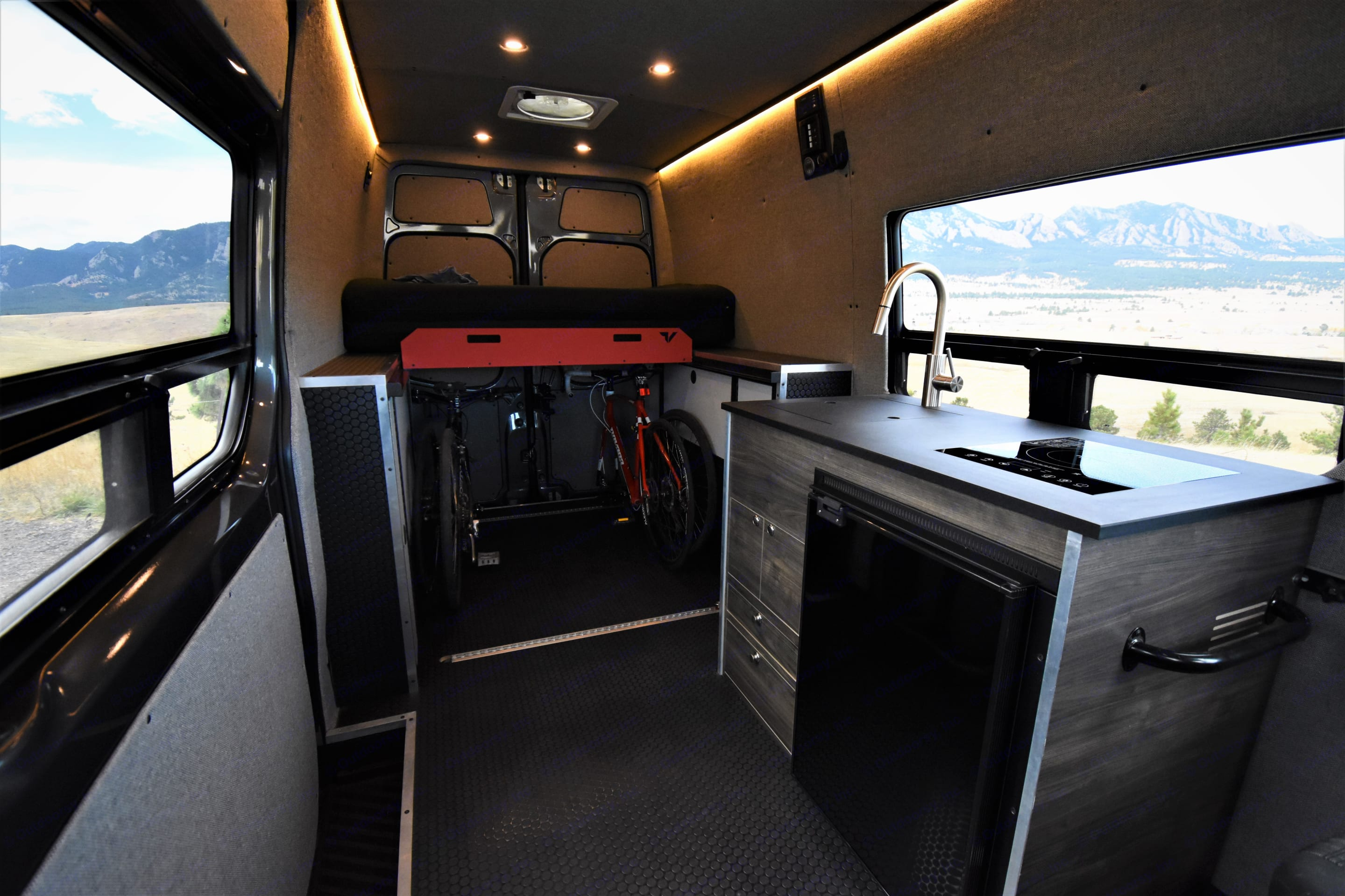 Kitchen and bed folded over for extended cab space.. Mercedes-Benz Sprinter 2019