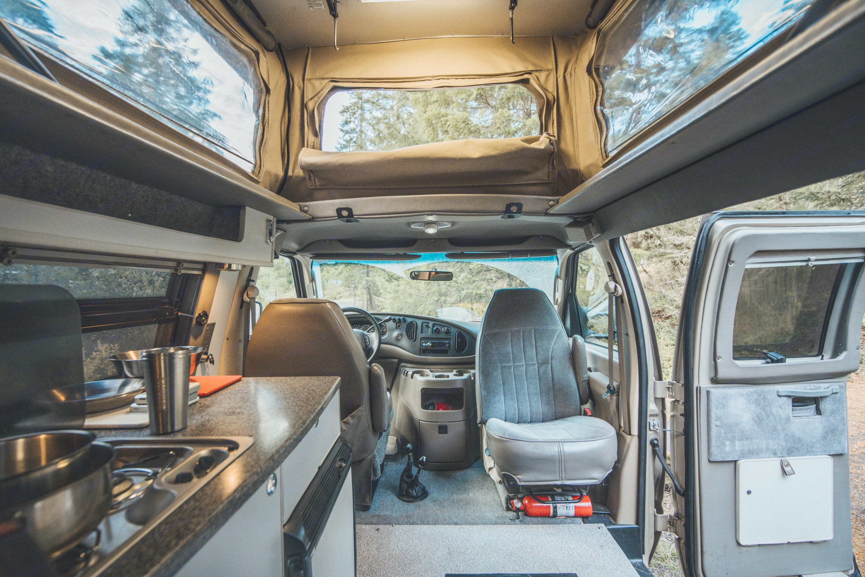 Full kitchen and front swivel seat makes for perfect hanging out zone.. Ford Econoline 2008