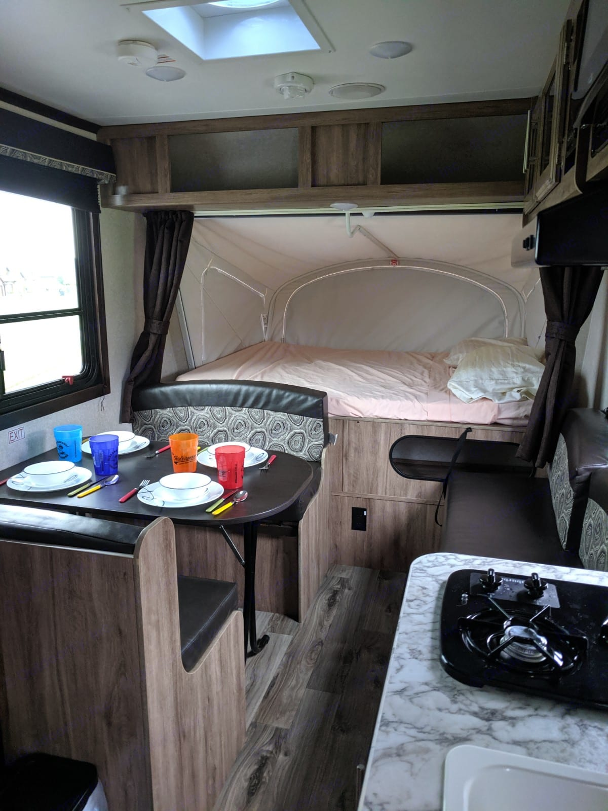 This is a view of one of the fold-out canvas top beds and the table. Both beds are almost queen size beds. They measure 57 x 68. . Jayco Jay Feather 2018
