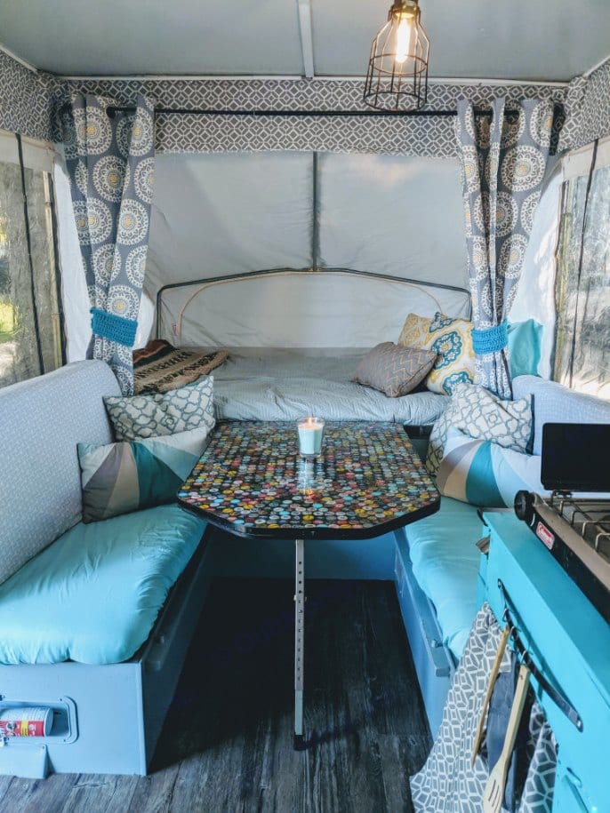 Sit down and have a cold brew while admiring the mosaic beer cap and resin table top. It also turns in to a bed for two!. Jayco 806 1992
