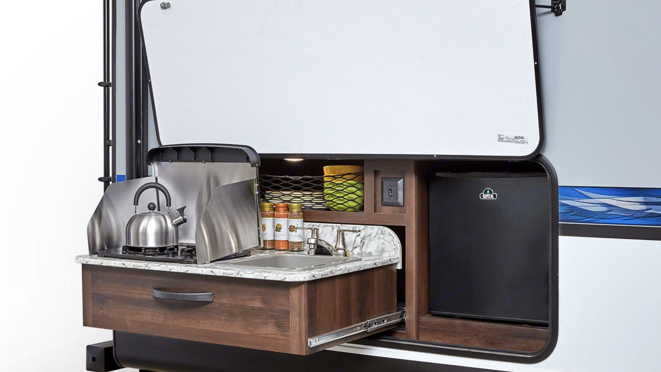 Convenient outside kitchen for all your cooking needs! Keep the messy cooking and smells outside and enjoy outdoor cooking!. Jayco Jay Feather 2019