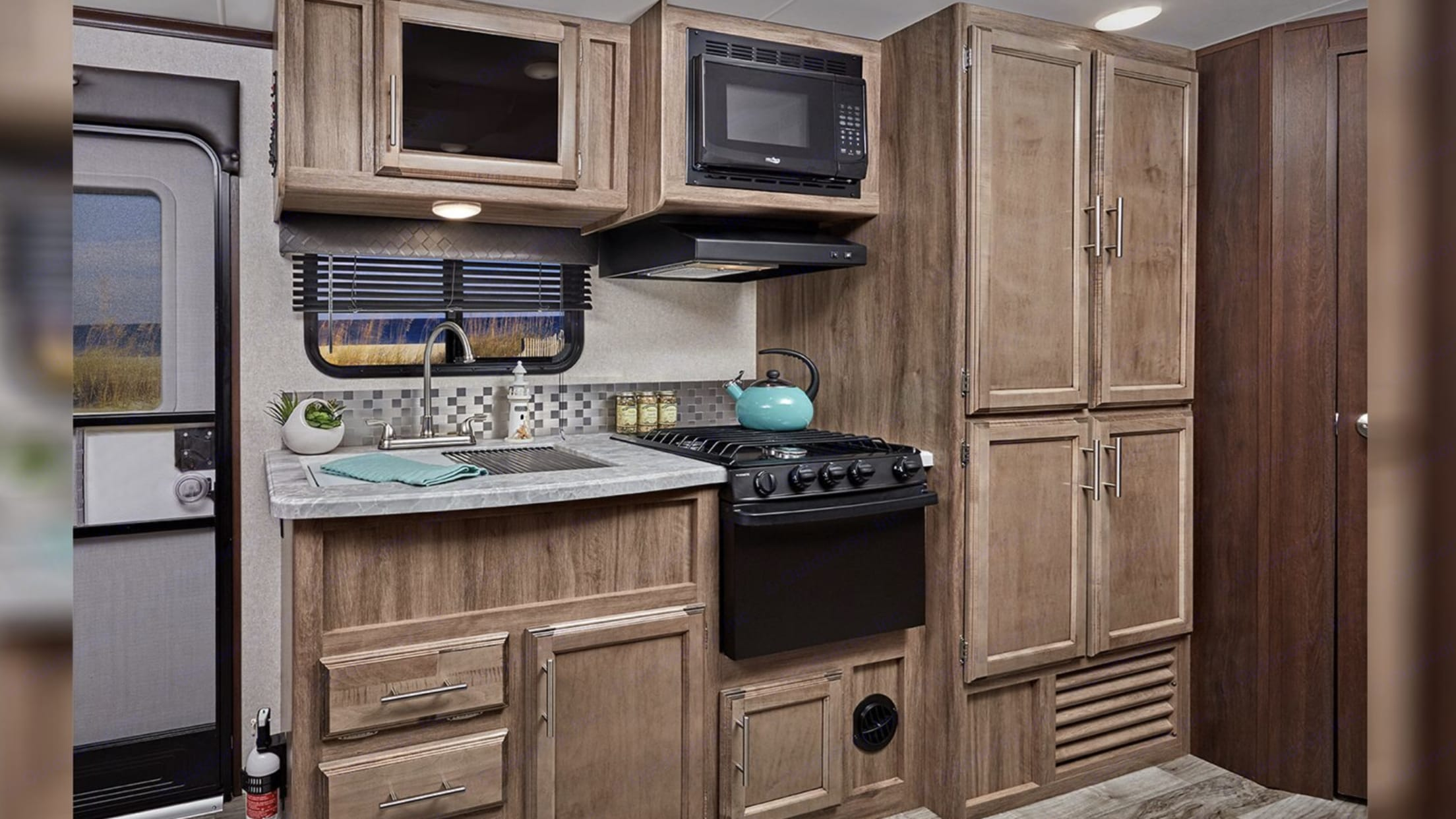 All you need to cook all your meals! Plenty of dishes,bowls, platters, glasses, silverware and every utensil you need. Coffee maker, toaster, electric griddle to outside to make the perfect pancake!  Storage for all your food.  . Jayco Jay Feather 2019