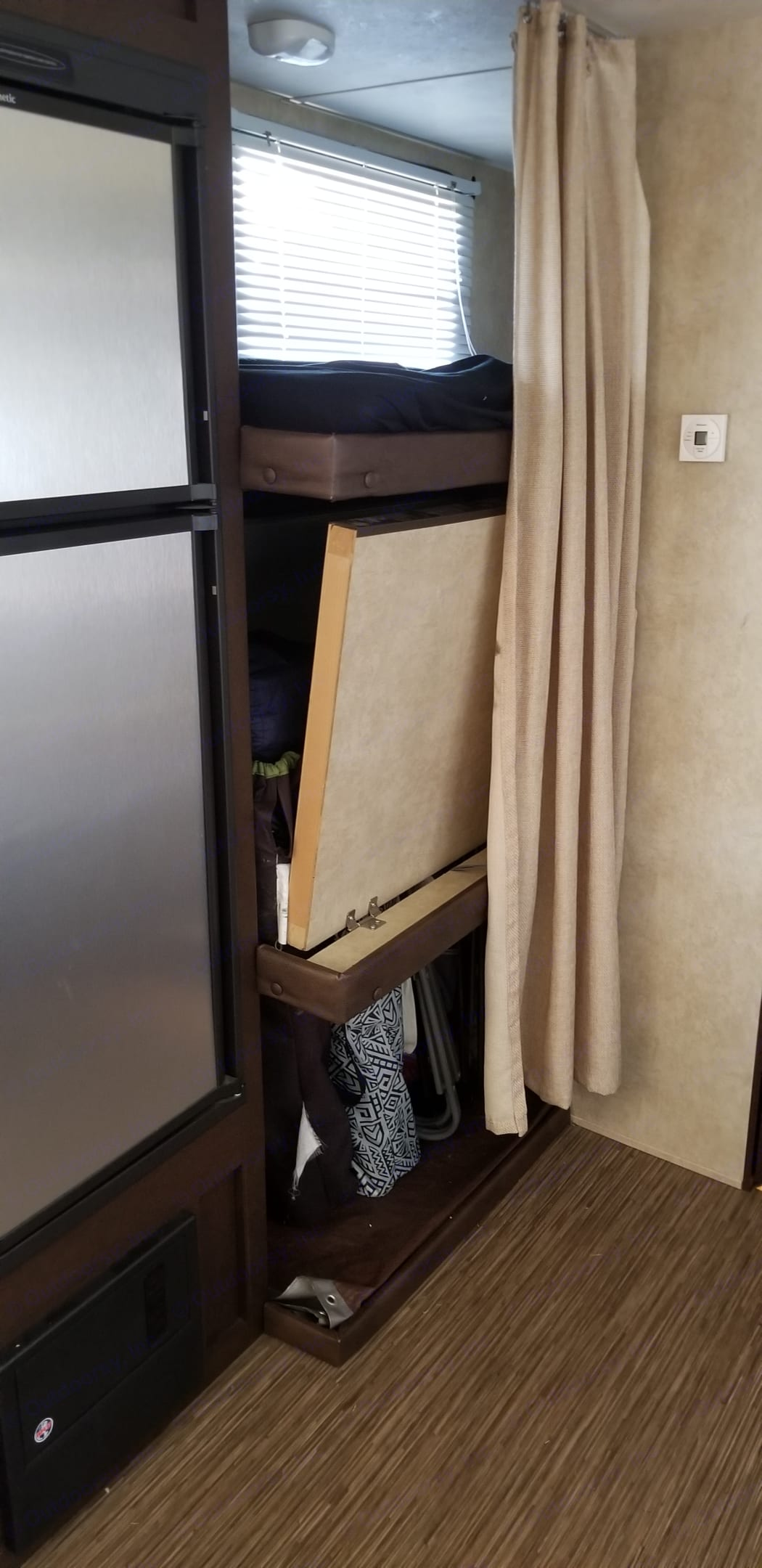 3 bunk beds pictured or used for storage. Forest River Evo 2014