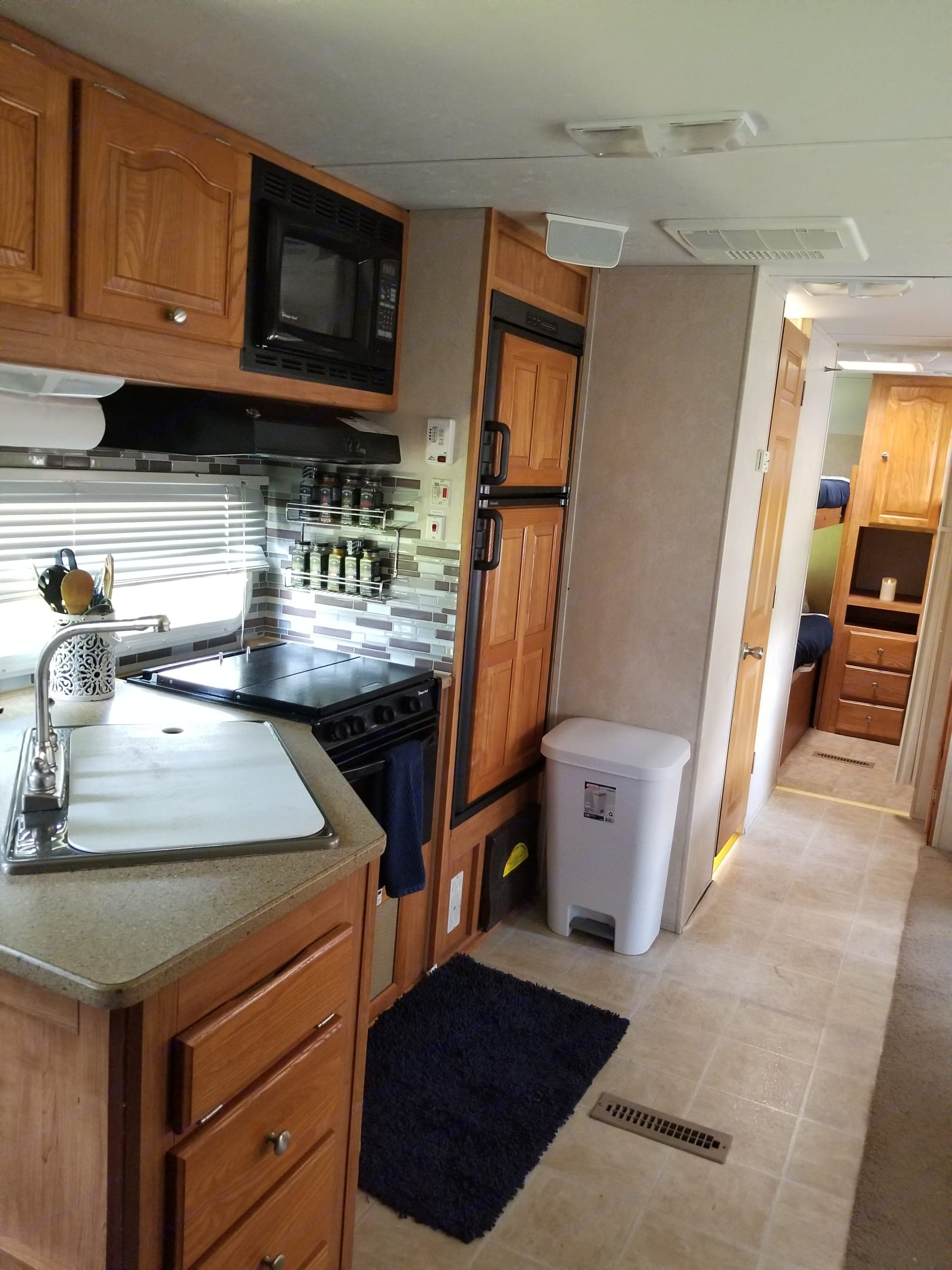 Kitchen with modern backsplash with all amenities.  Fully loaded kitchen down to spices!. Featherlight Trailers Flagstaff 2010