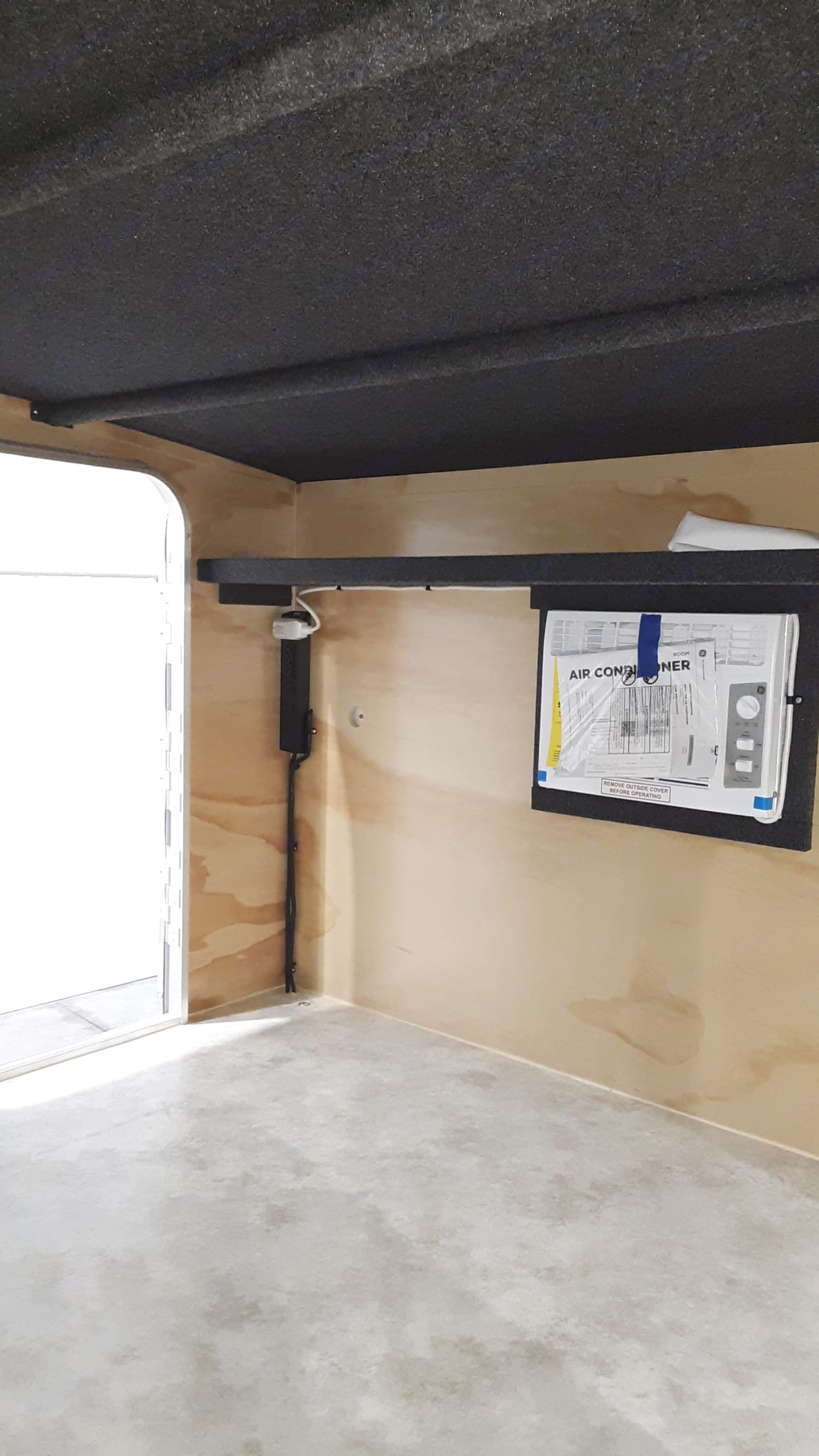 Shelf above the Air Conditioner is a great place to put small personal belongings before going to bed at night.  Keep all valuables locked in your car. Runaway Campers Rangerunner 2019