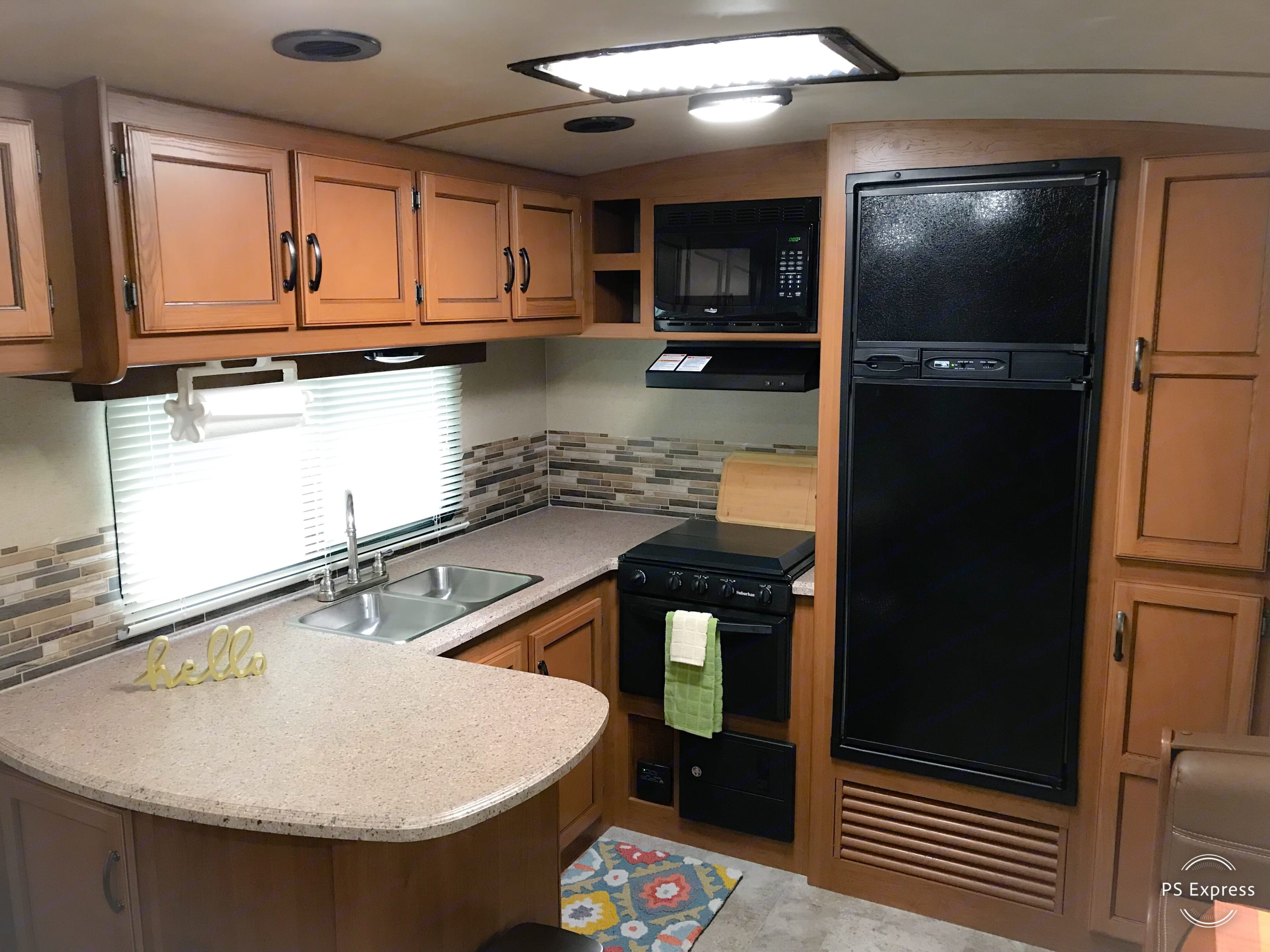 Kitchen with stove, microwave, and refrigerator. Tons of storage to include a pantry.. Crossroads Sunset Trail Super Lite 2016