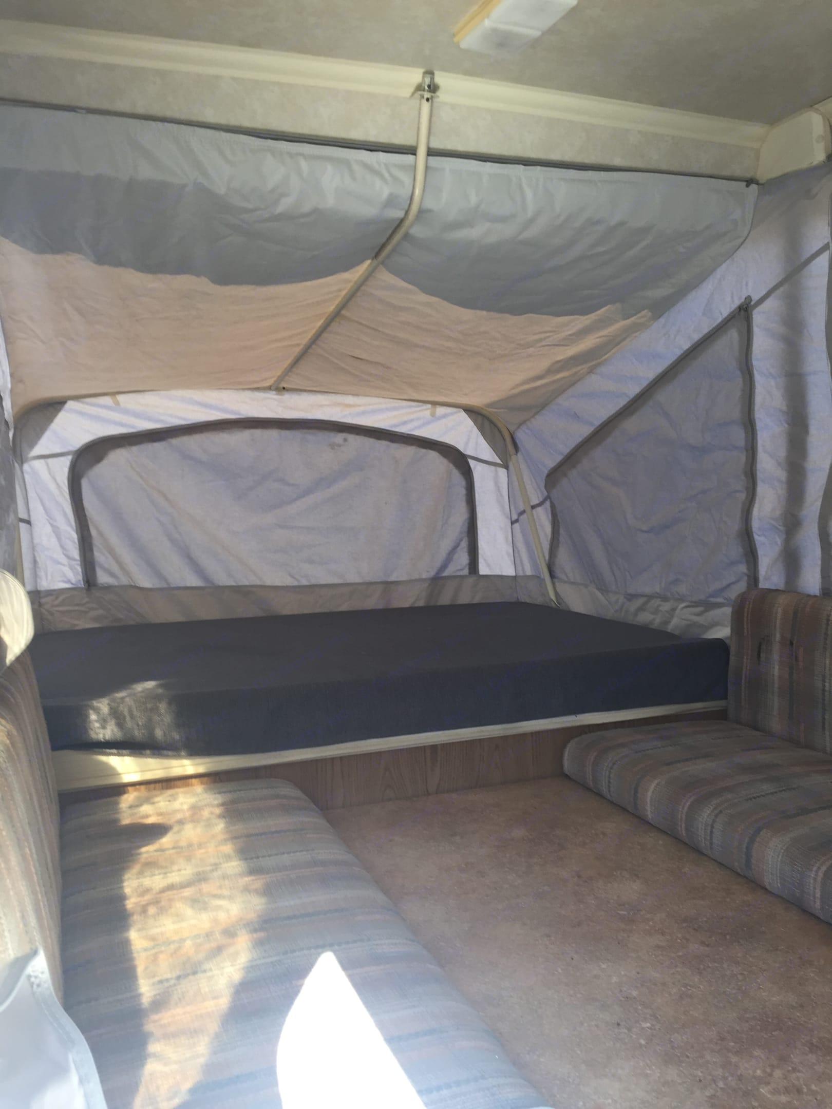 The king size bed and table area that turns into a bed.. Coleman Grand Tour Shenandoah 1989