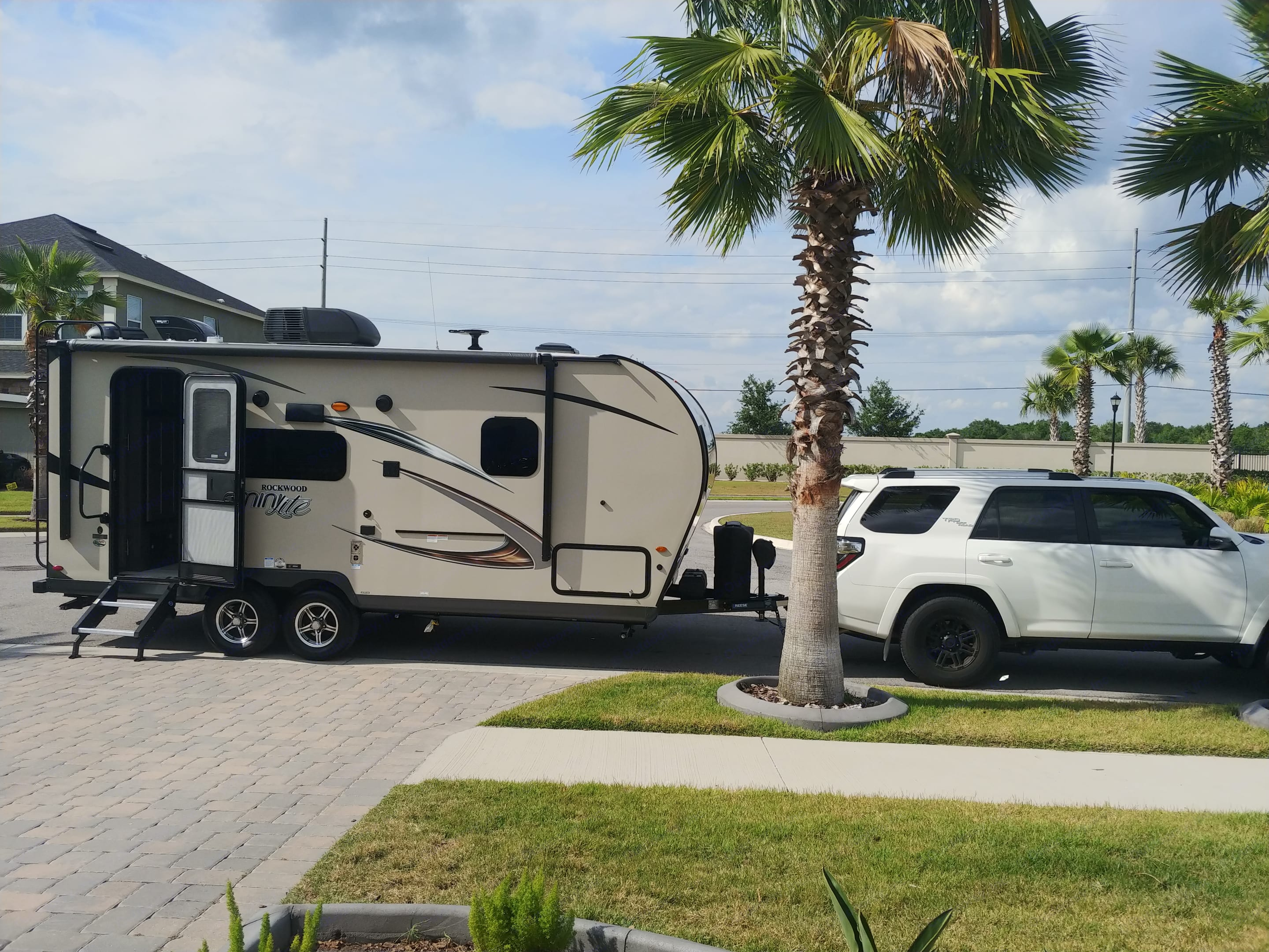 Compact, light and spacious! Electric awning pulls out over this side of the trailer and propane grill attached to side rail.. Forest River Rockwood Mini Lite 2019