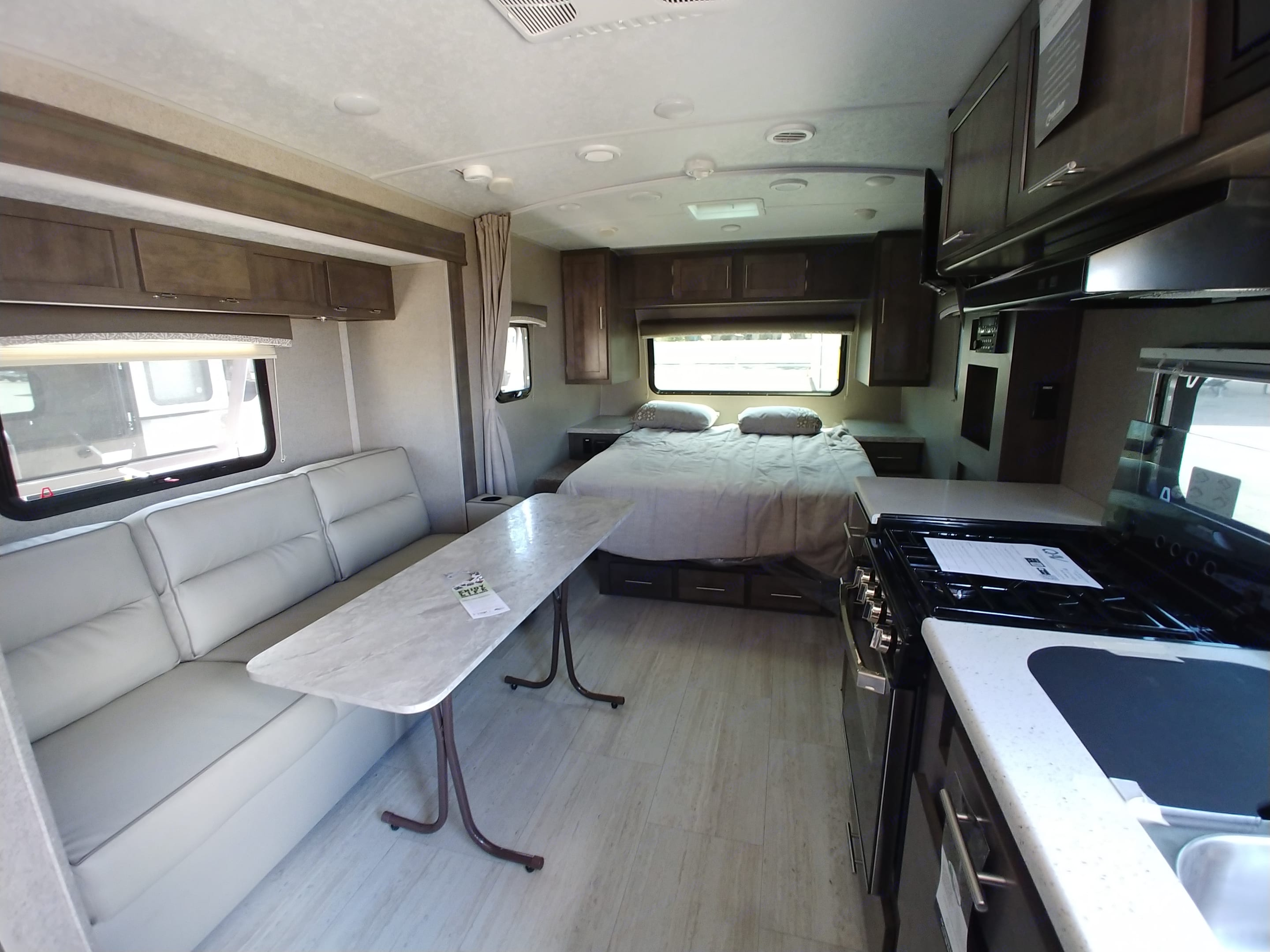 RV Queen with egg crate cushioning, slide-out with fold-down couch and table that can be stored behind it. Lots of storage!. Forest River Rockwood Mini Lite 2019