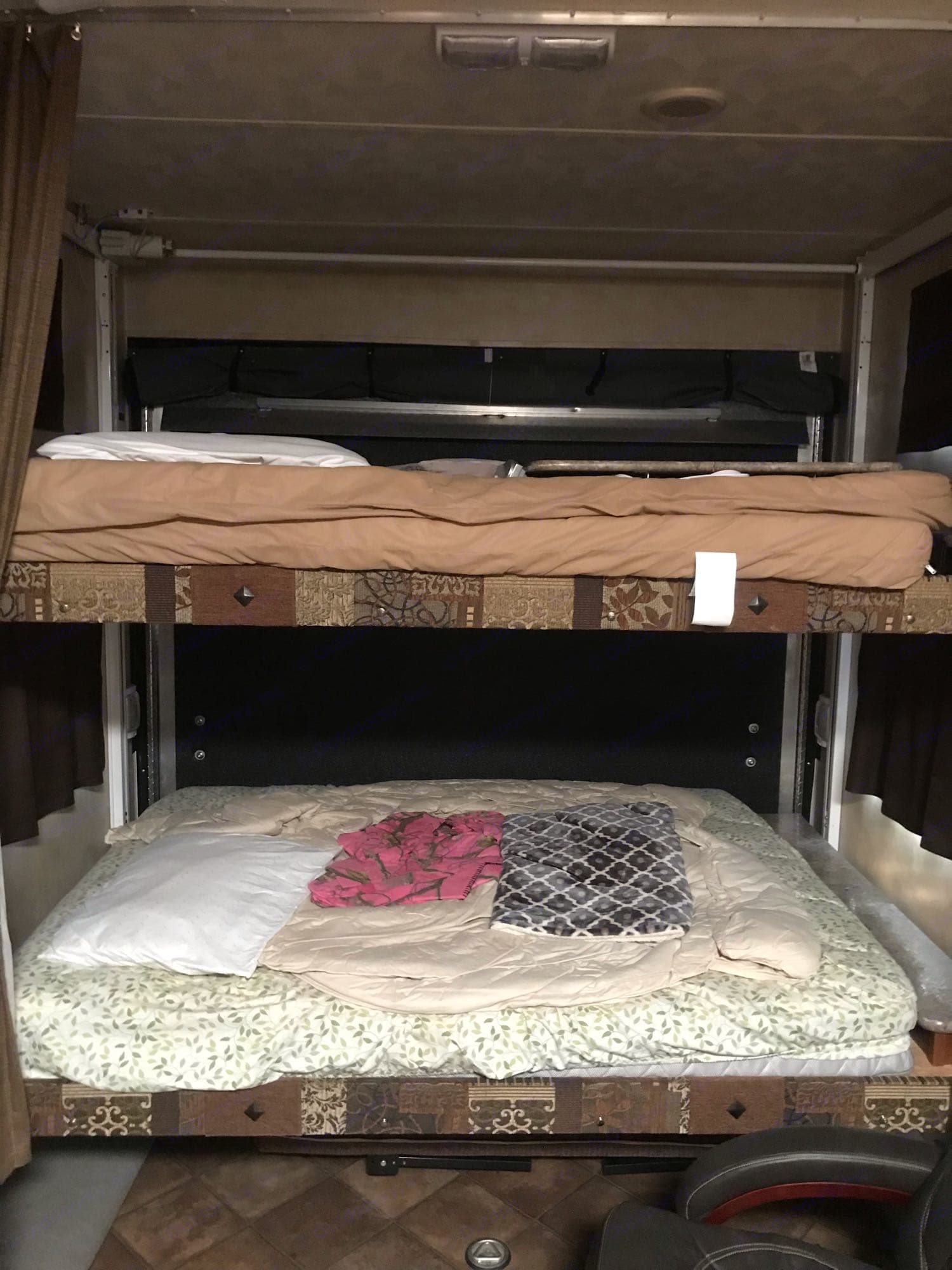 2 queen bunks in the back. ForestRiver Puma 2013