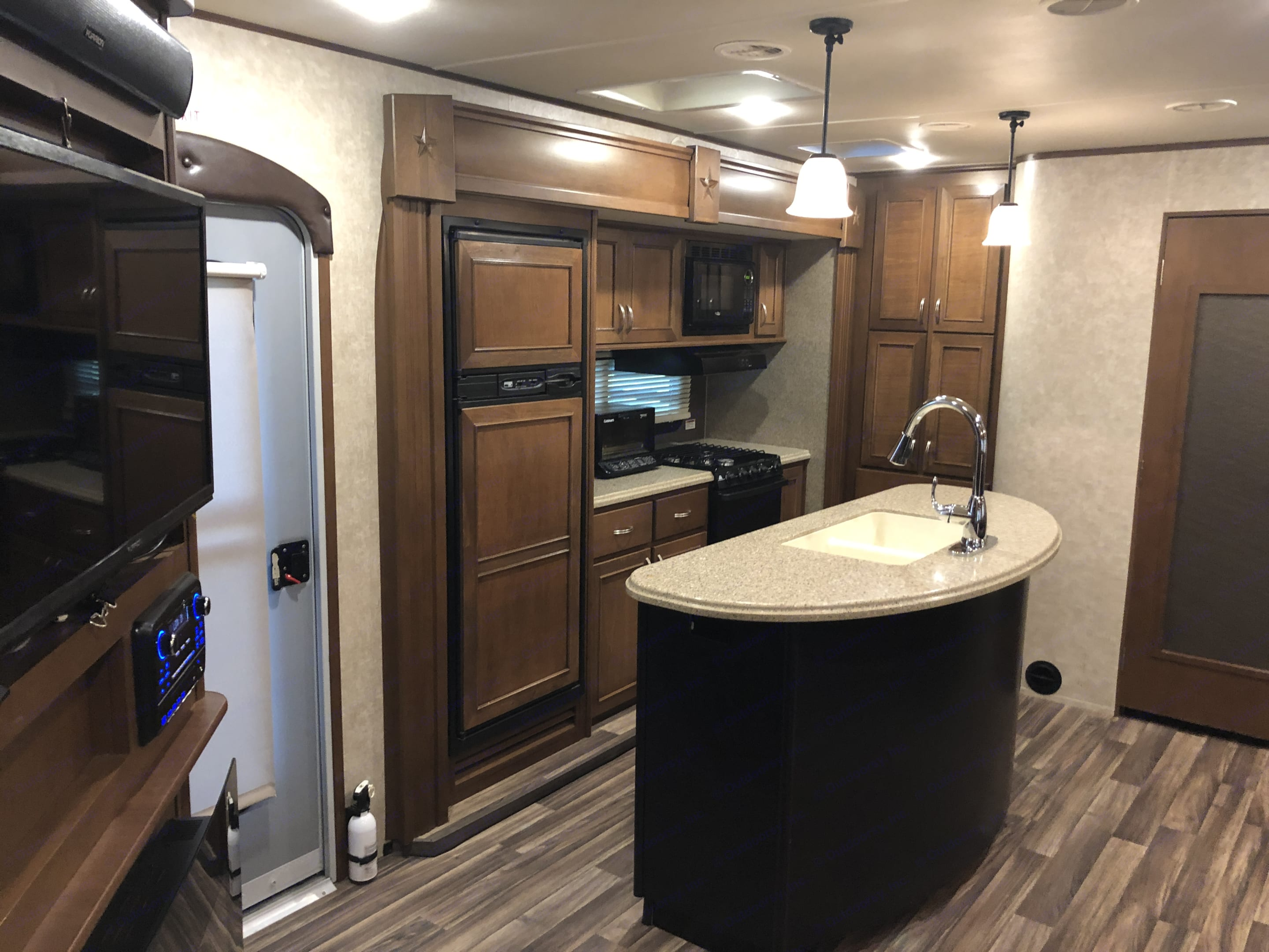 Nice size kitchen with a kitchen island. Cook while you your friends and family lounge on the extra large couch while listening to music or watching TV.. Open Range Roamer 2016