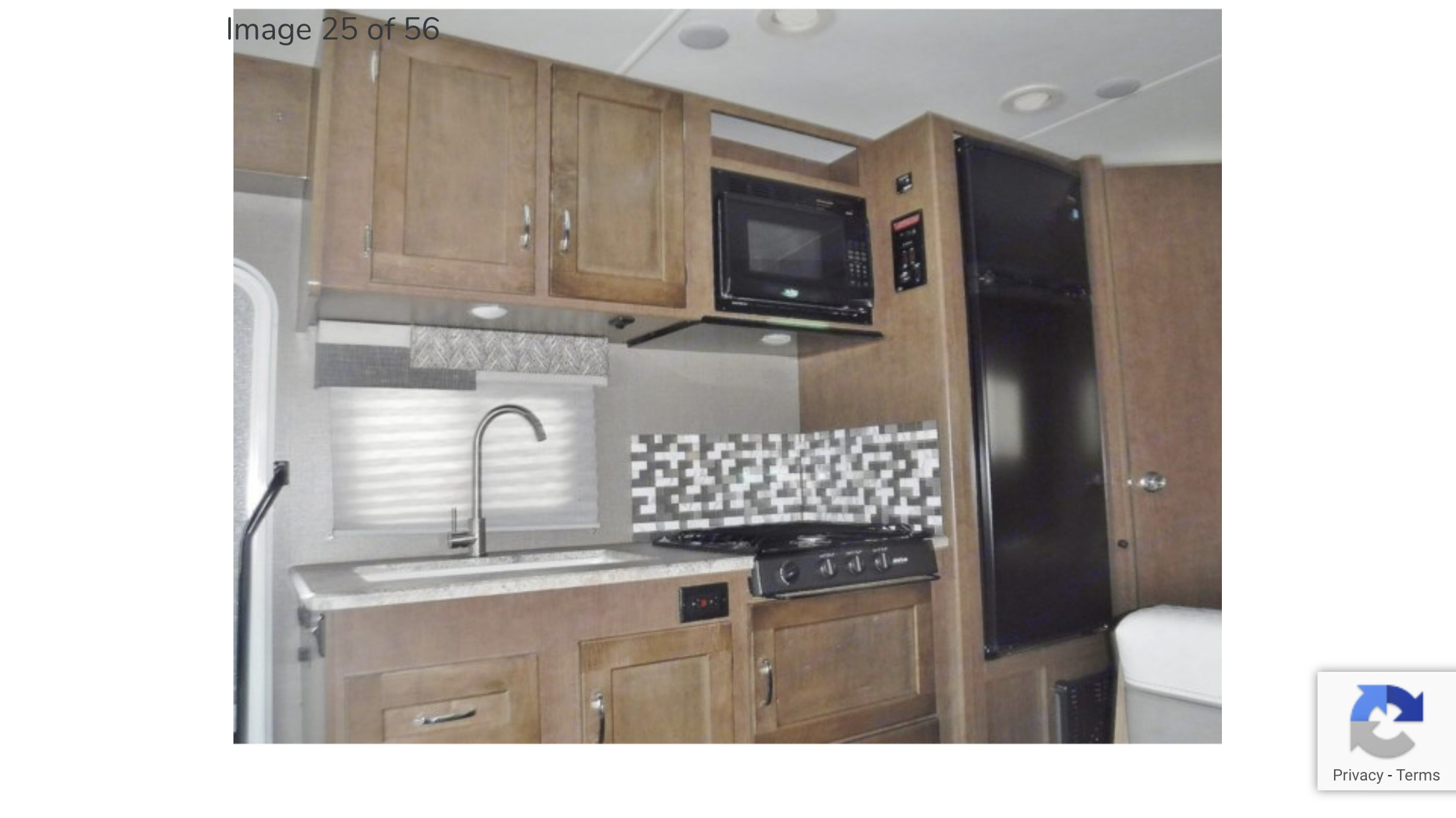 Kitchen, no stove, just stovetop.  Love the backsplash and two compartment sink.  Windows so you can look out if you get stuck doing dishes.. Winnebago Outlook 2019