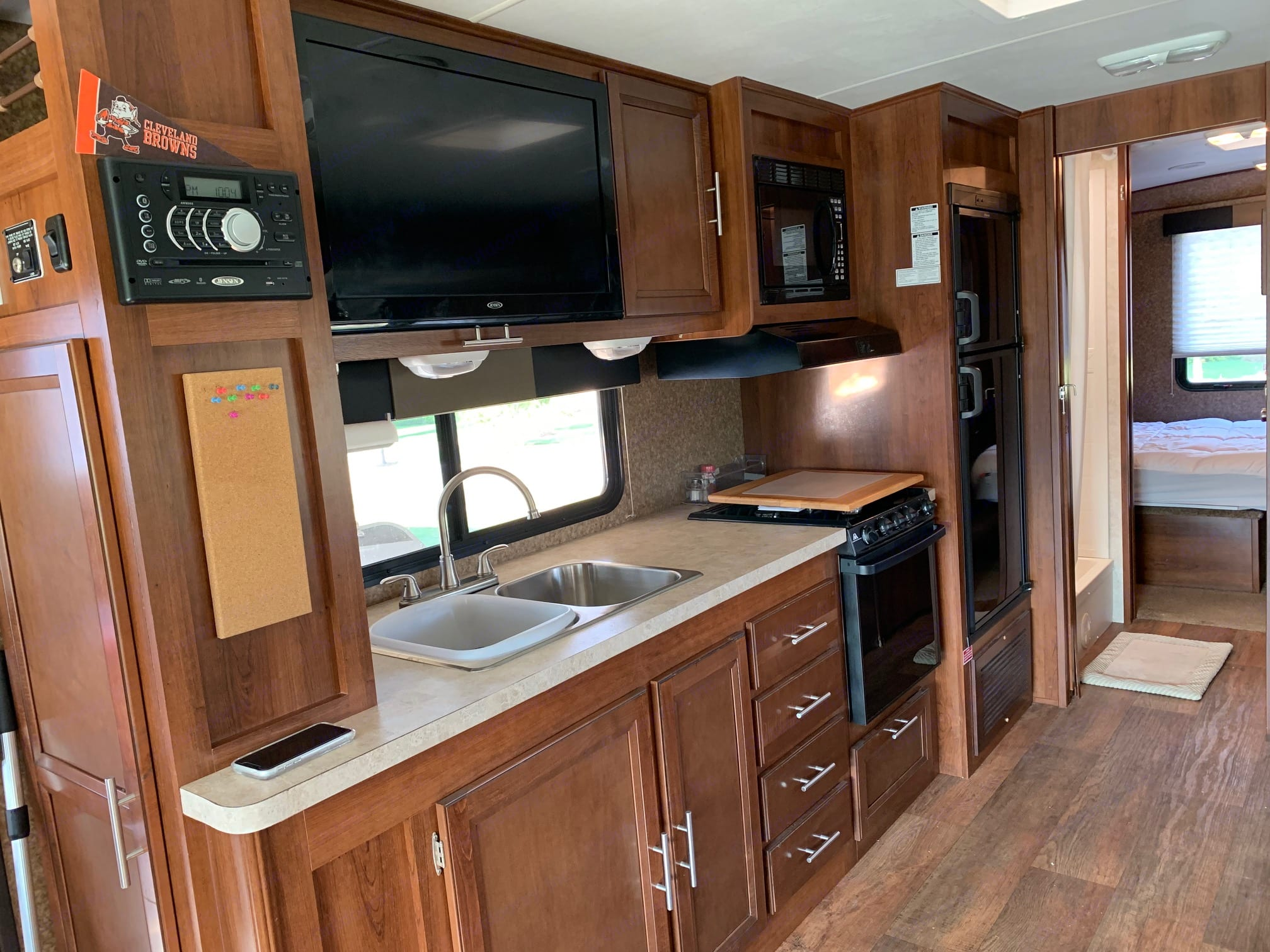 Pantry behind big screen TV. Forest River FR3 2014