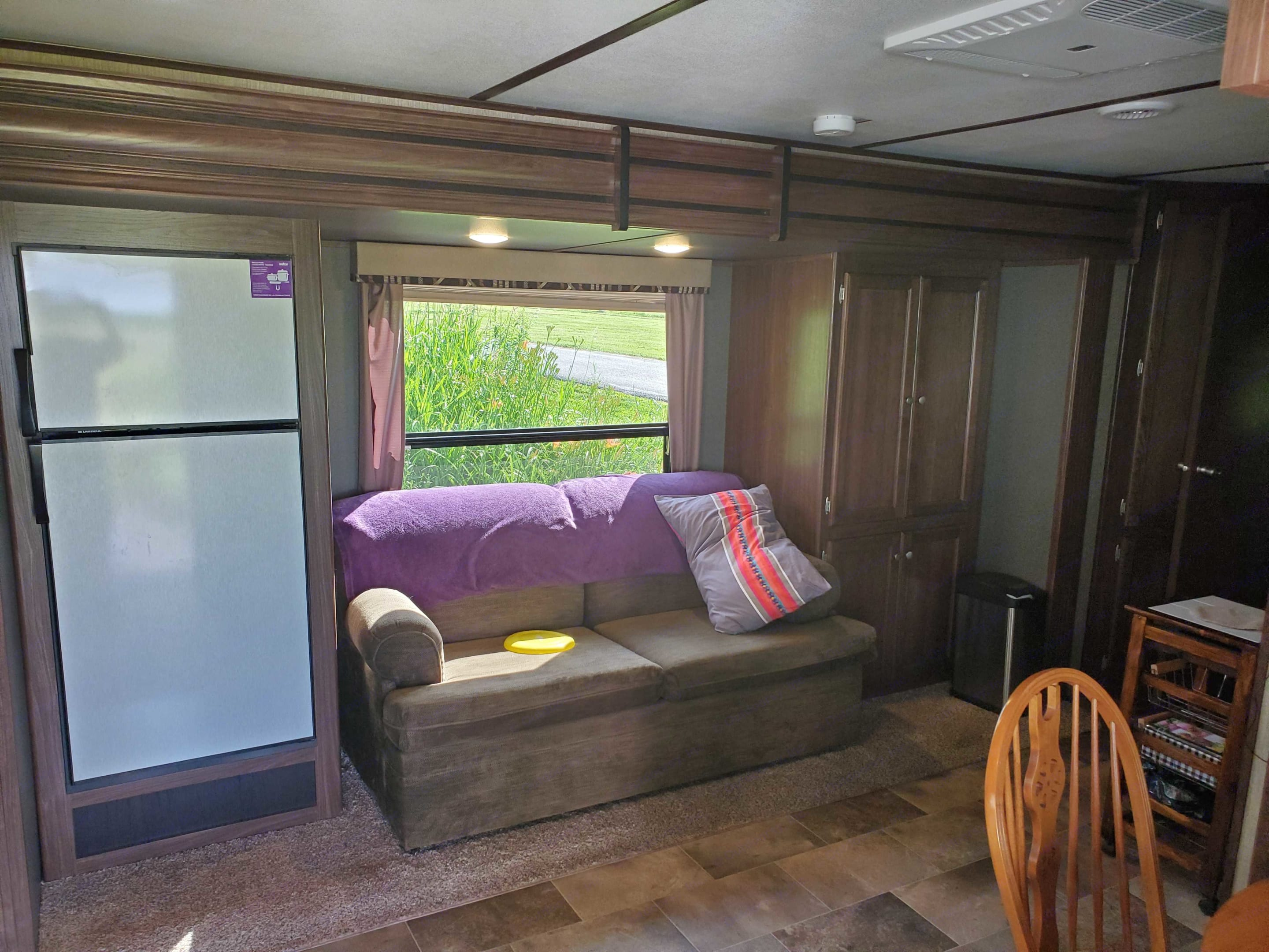 The two door fridge has a large capacity freezer. The hide-a-bed makes into a comfortable double bed.  This is not a trailer supplied love seat.  This has a much better mattress and you cannot feel the cross bars on your back.. Keystone Sprinter Campfire 2017