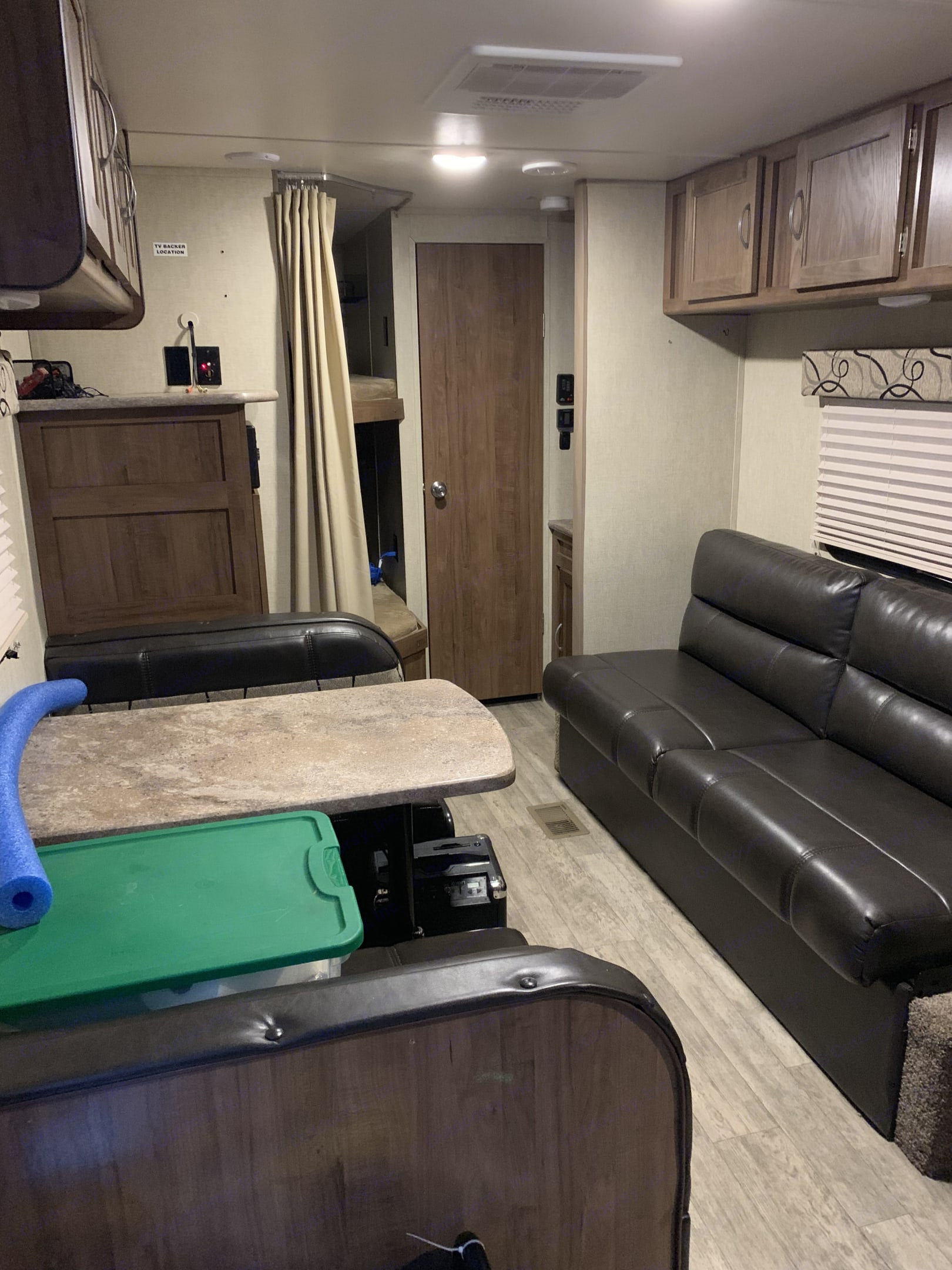 Dining room table and fold out coach. GulfStream Kingsport 2018