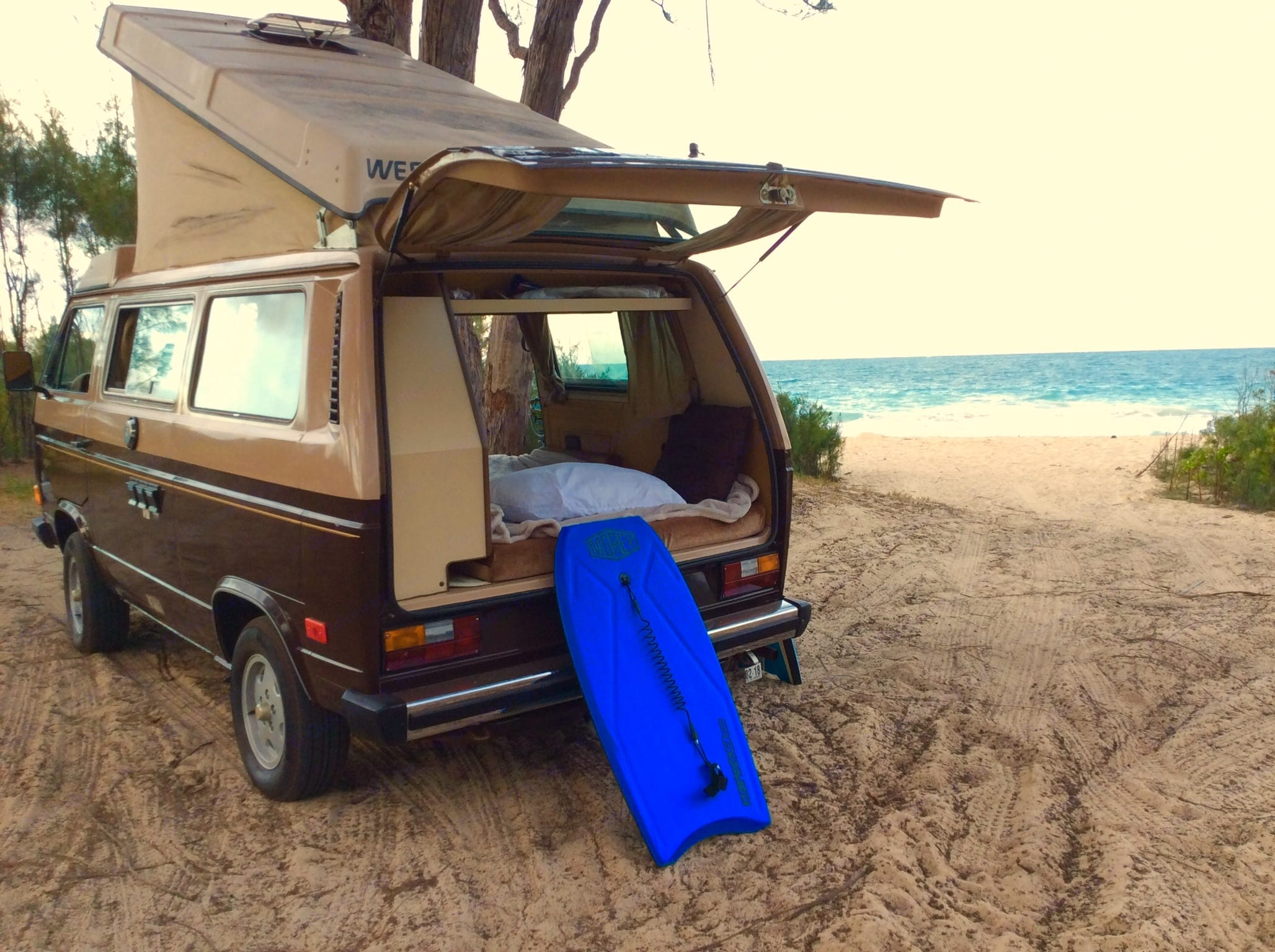 With a large rear hatch and a reversible back seat, you can easily create a perfect, cozy beachside couch.. Volkswagen Vanagon Westfalia 1984