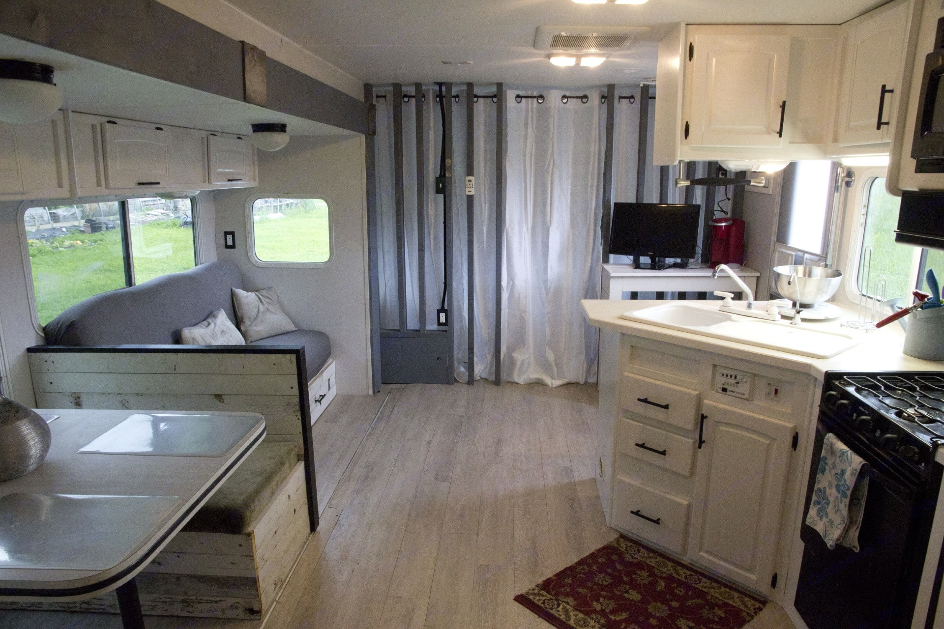 Master bedroom closed off with curtain. Thor Motor Coach Jazz 2005