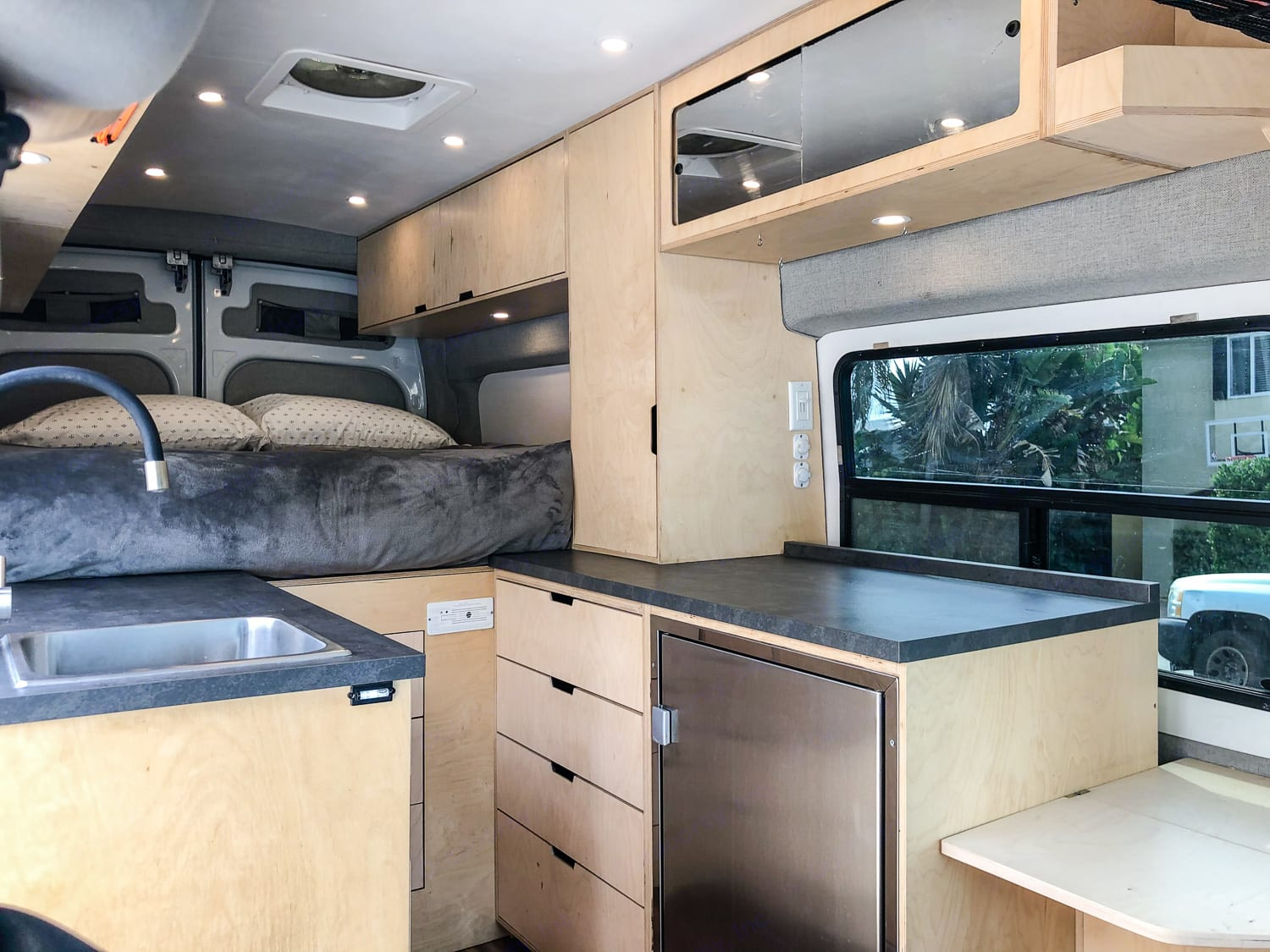 Welcome home! This fully custom van was thoughtfully designed with the full time traveler in mind. Try on VanLife and see how much you love it!. Ford Transit 2015