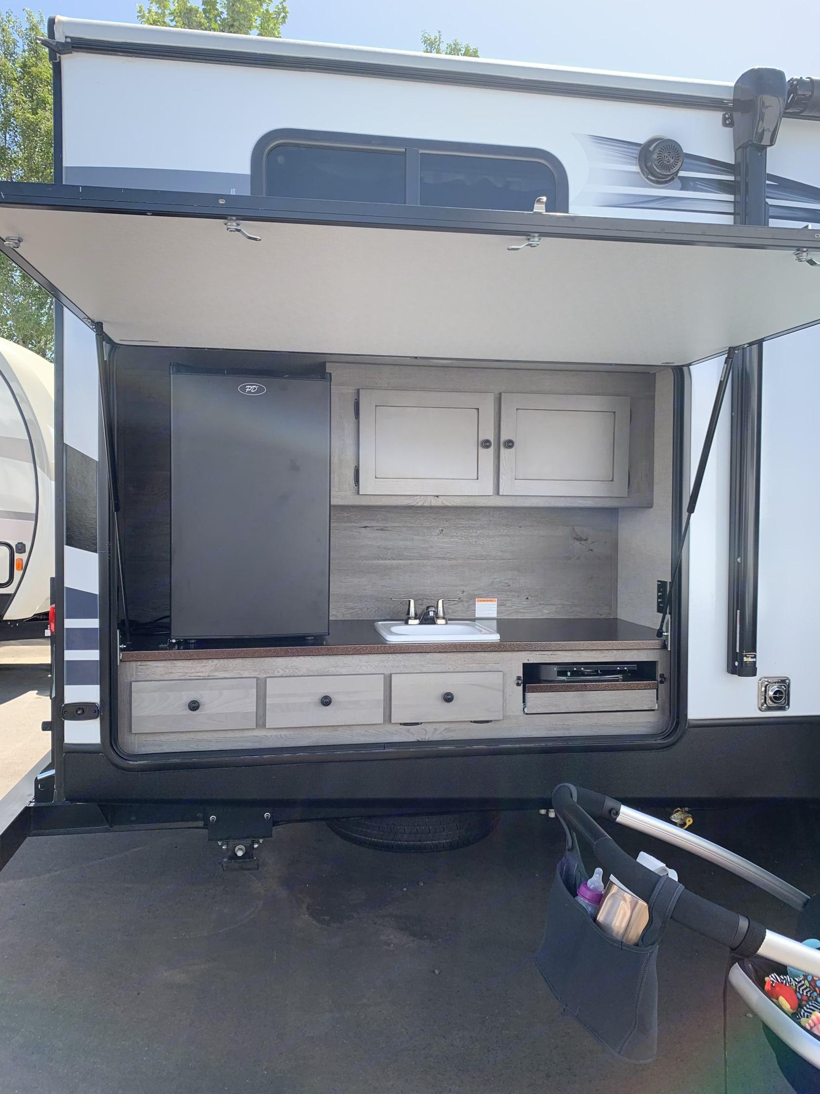 Outside Kitchen, fridge, sink and 2 burner stove, TV hook ups. Keystone Outback Terrain 2020