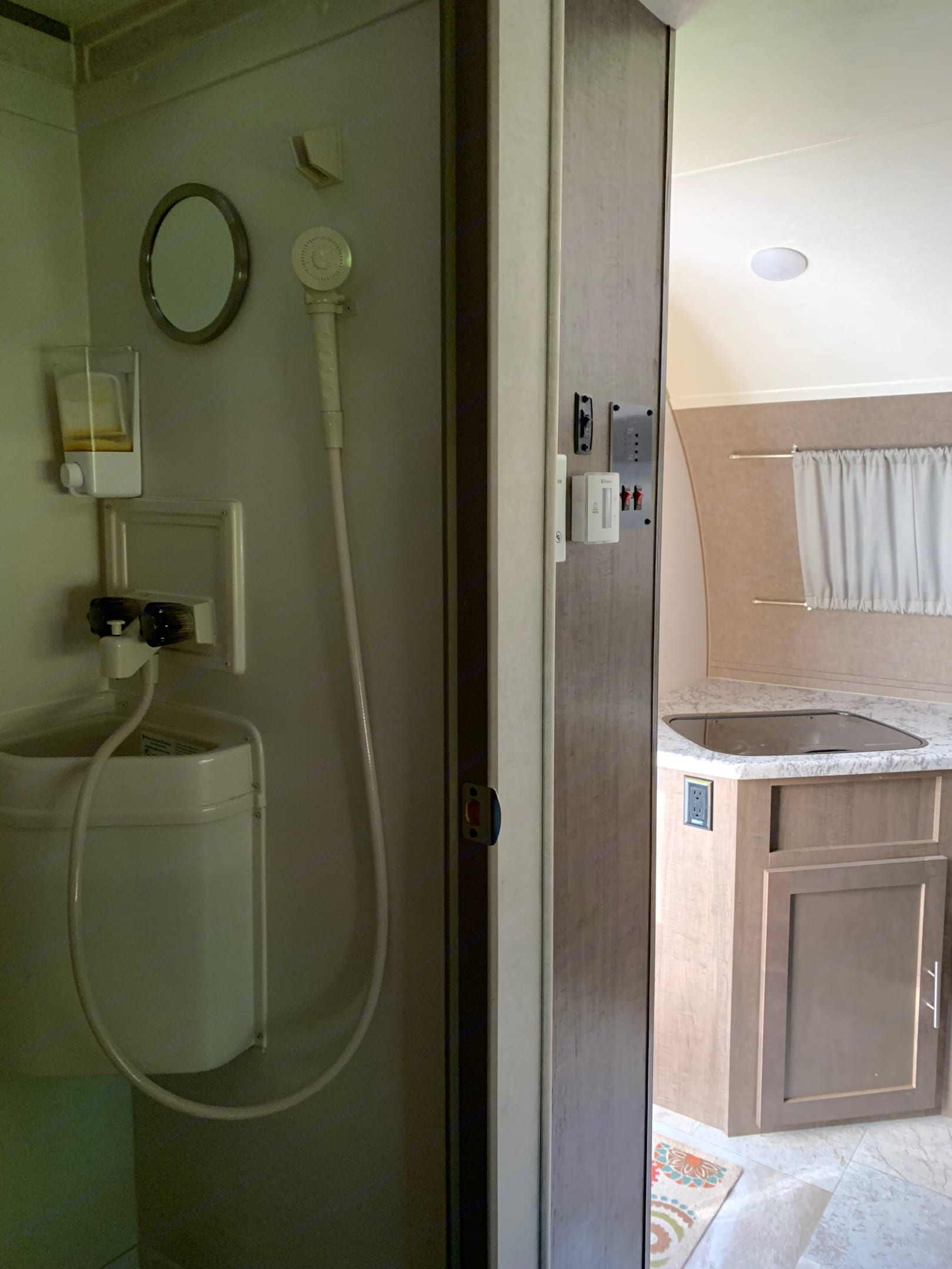 Bathroom with sink, toilet, & shower. (Fan and vent as well.). Forest River R-Pod 2018