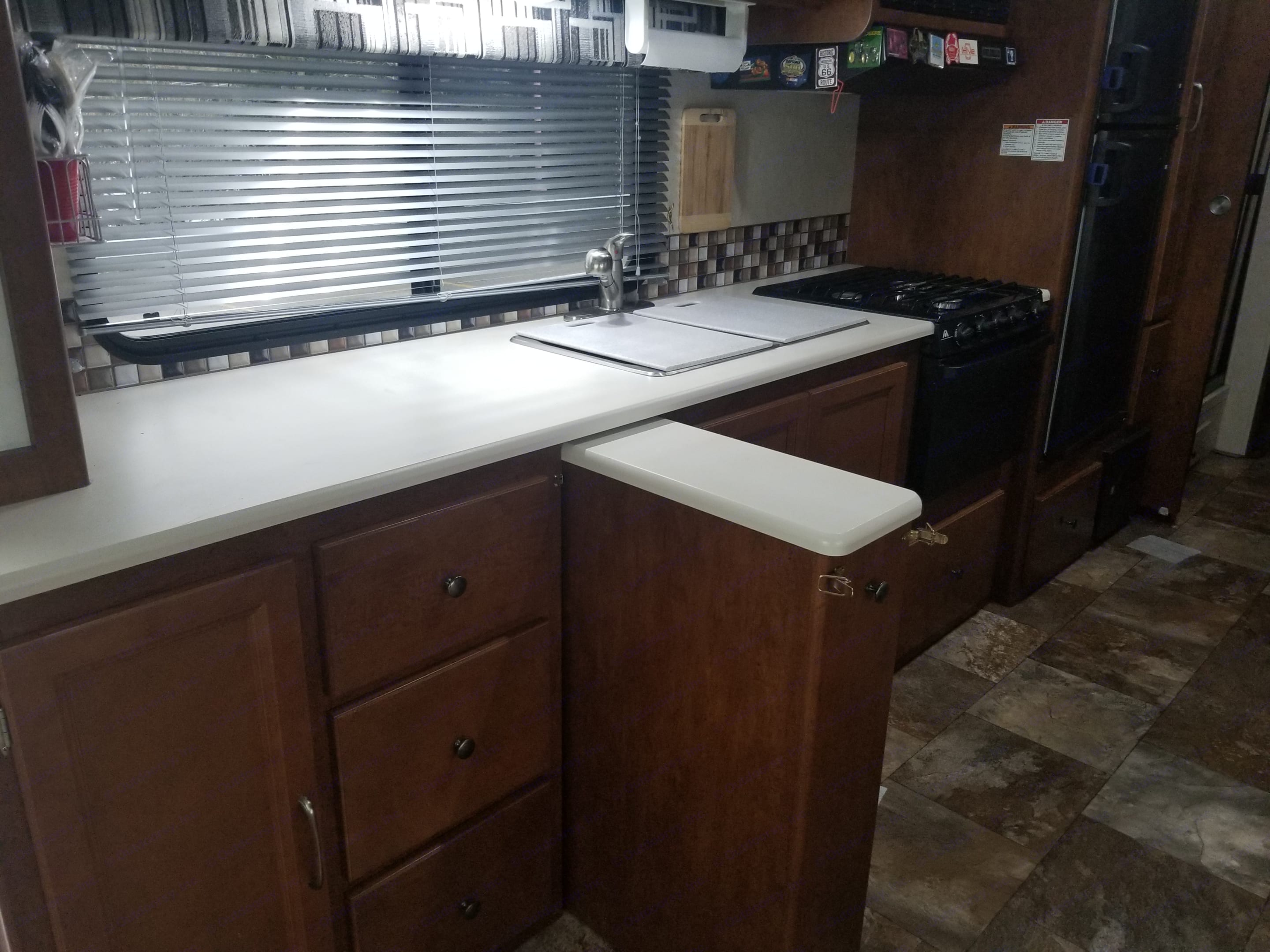 Slid out storage and additional countertop space. Coachmen Pursuit 2014