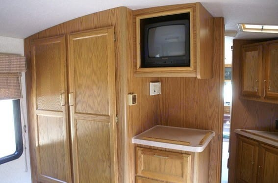Full closet for hanging clothes and extra blanket storage. Fleetwood Bounder 34J 1994