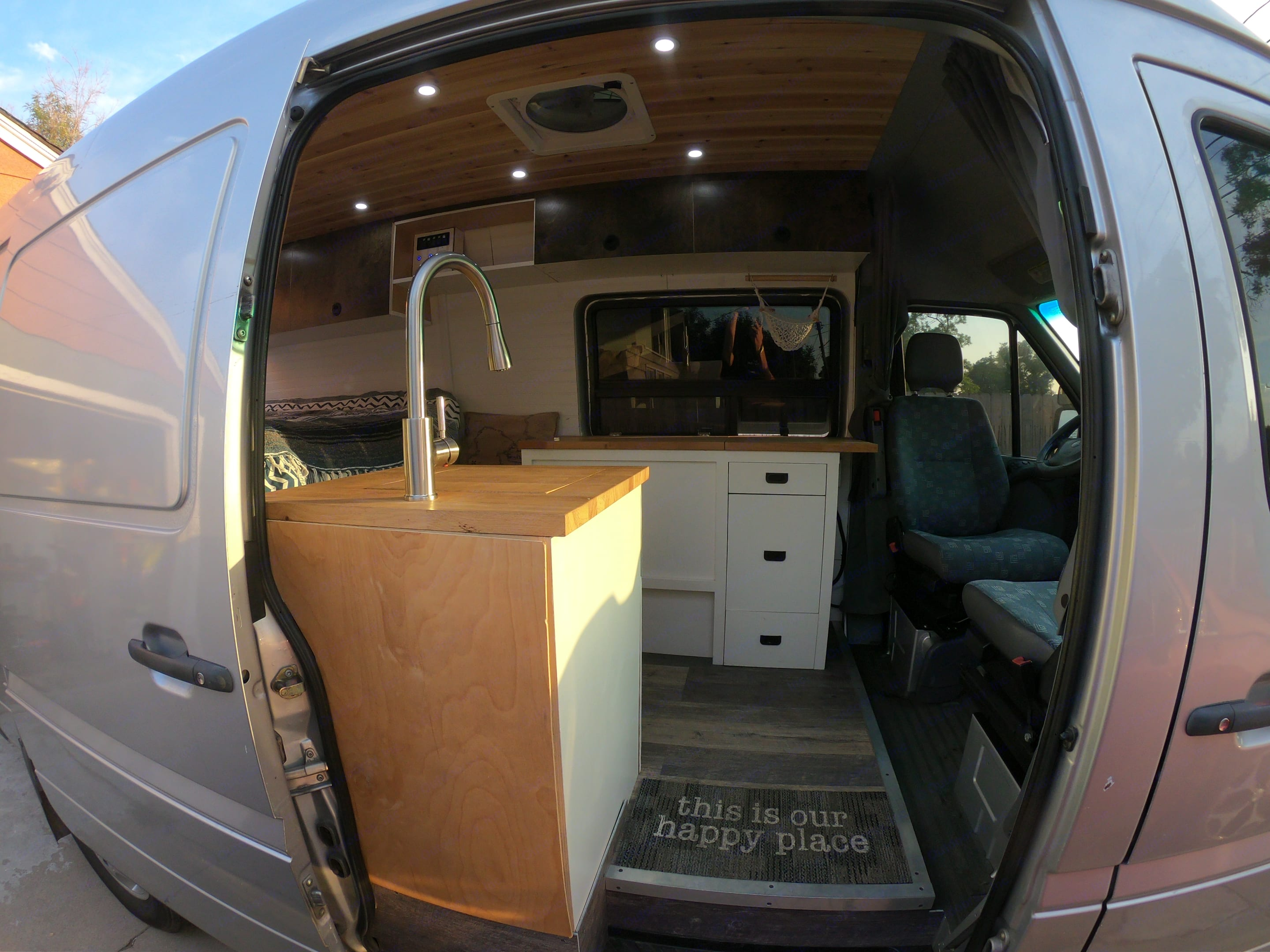 Multi-functional sink cabinet with plenty of food prep space with the best view in the house . Dodge Sprinter 2006