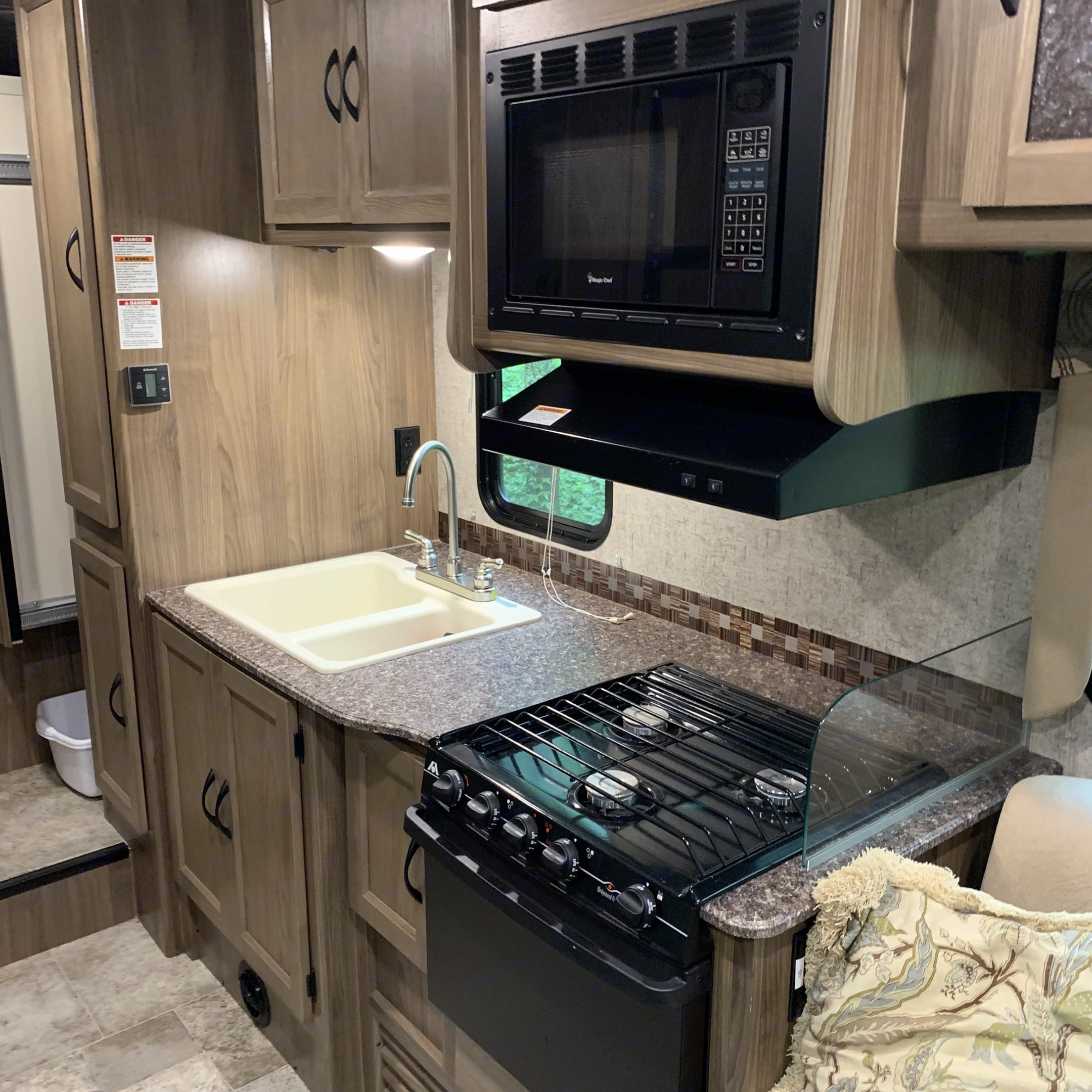 Double sink, microwave, 3 burner stove, oven, pantry, tons of empty storage for your food!. Coachmen Freelander 2017
