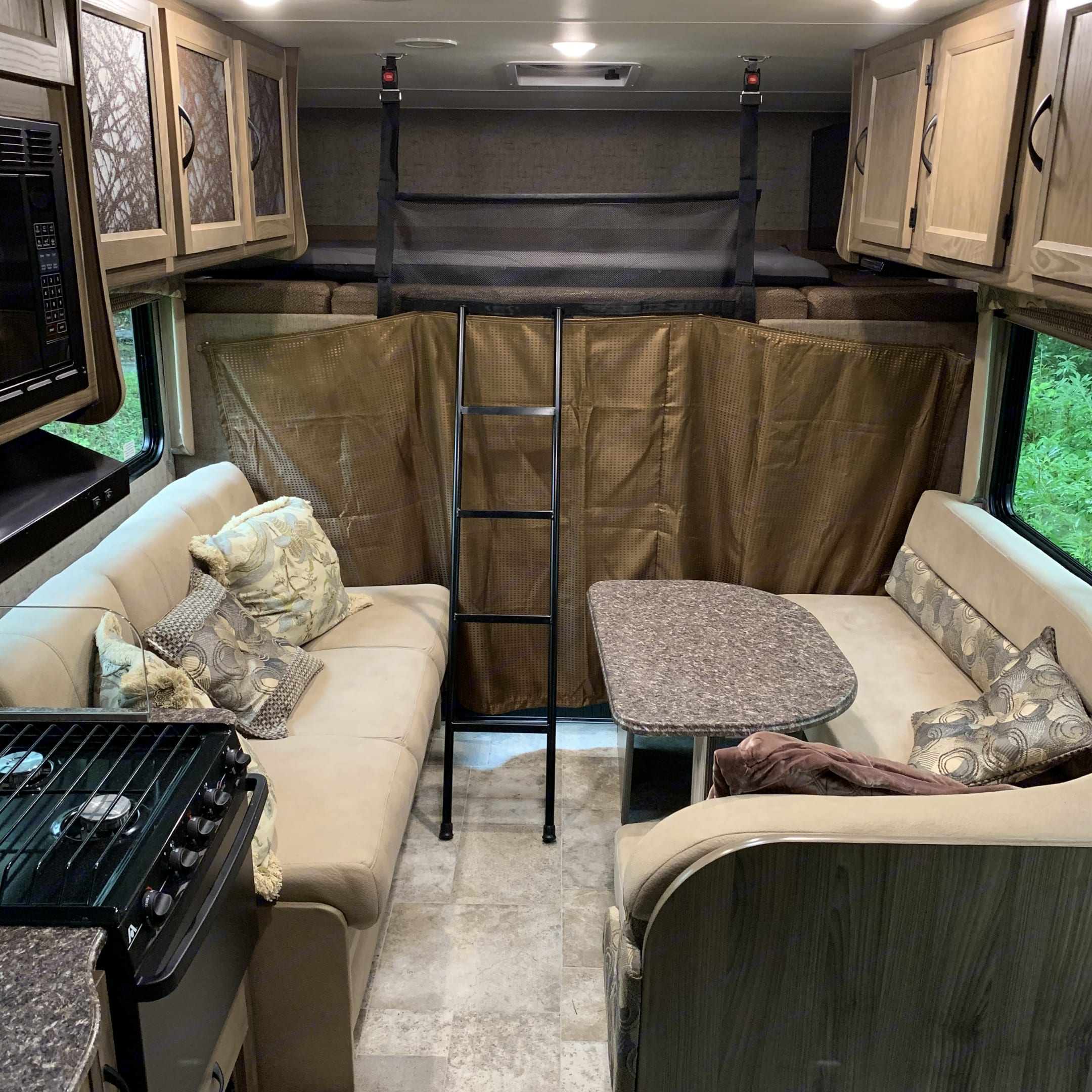 Ladder can but stored on the top bed leaving lots room in living room. Coachmen Freelander 2017