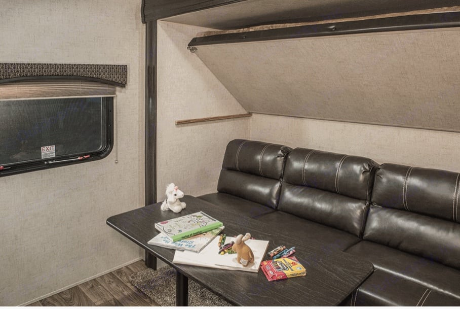 Right side of bunk room doubles as another seating area or two additional bunks . Venture Rv Sporttrek 2017