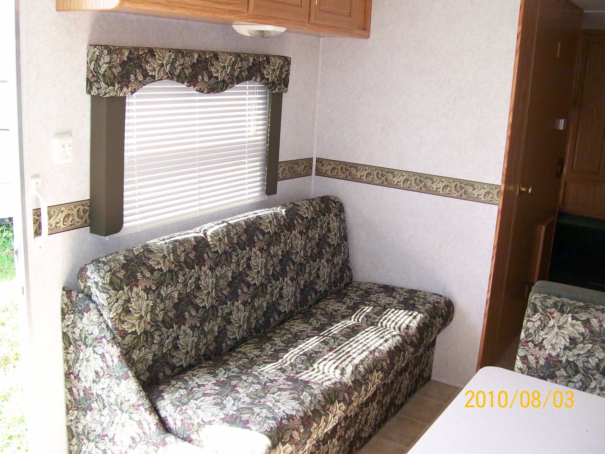 Couch and dinette both fold into additional sleeping space! . Dutchmen Sport 2002