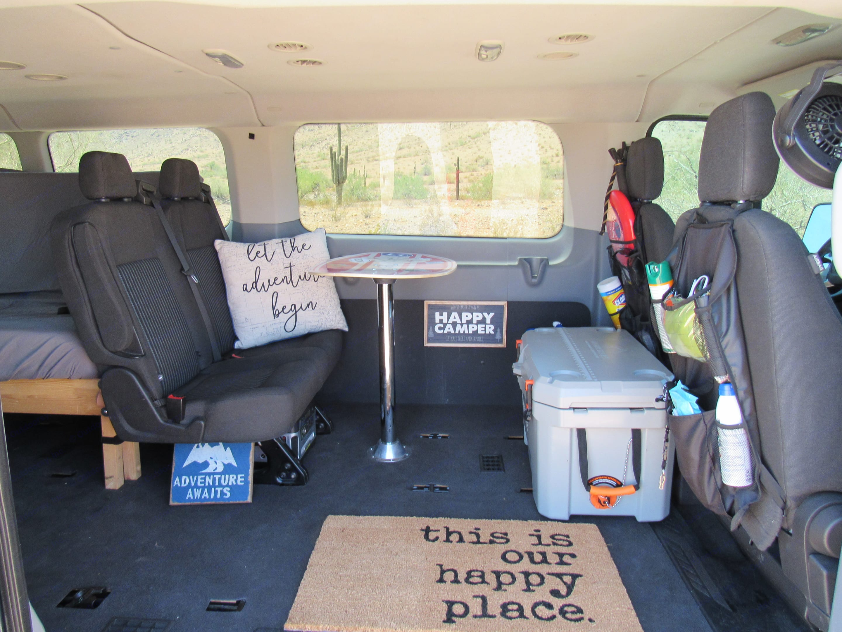 Rear factory seats with seat belts and a removable table.. Ford Transit 2015