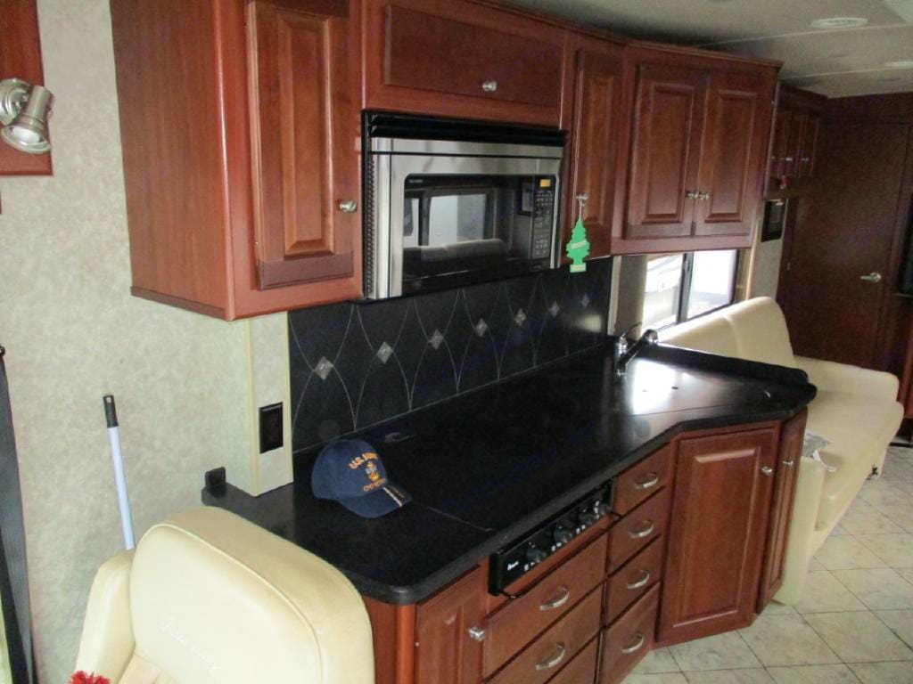 Kitchen w/double sink, microwave, 3 burners. Winnebago Journey 2010