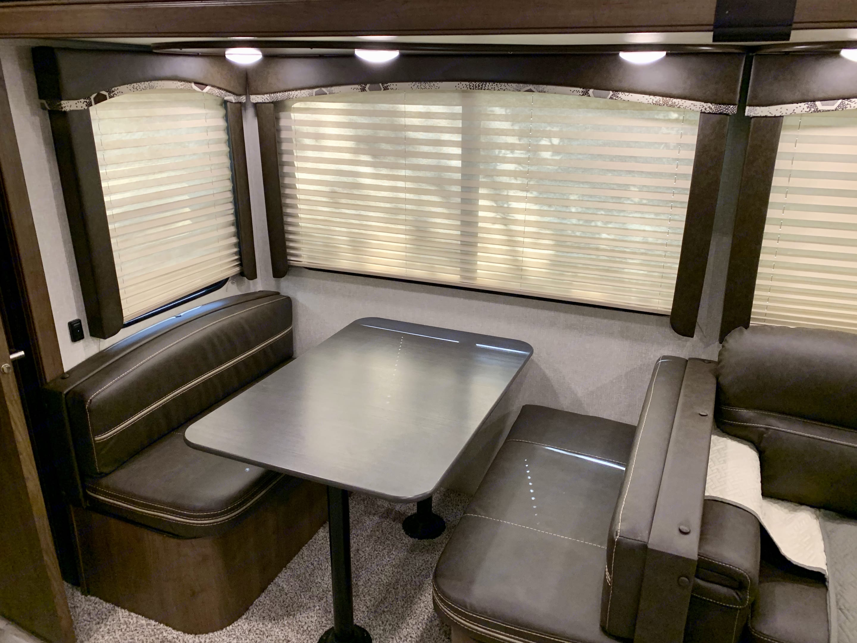 Living Space - Dining table with bench seats.  Converts to sofa bed.. Keystone Cougar 2020