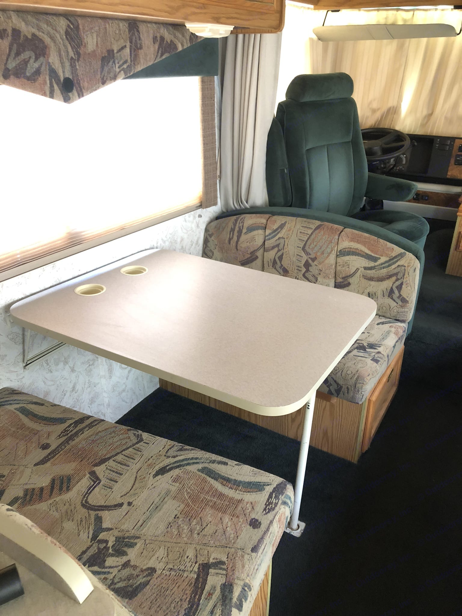 Dinette table that converts to a full size bed.. Itasca Sunrise 1997