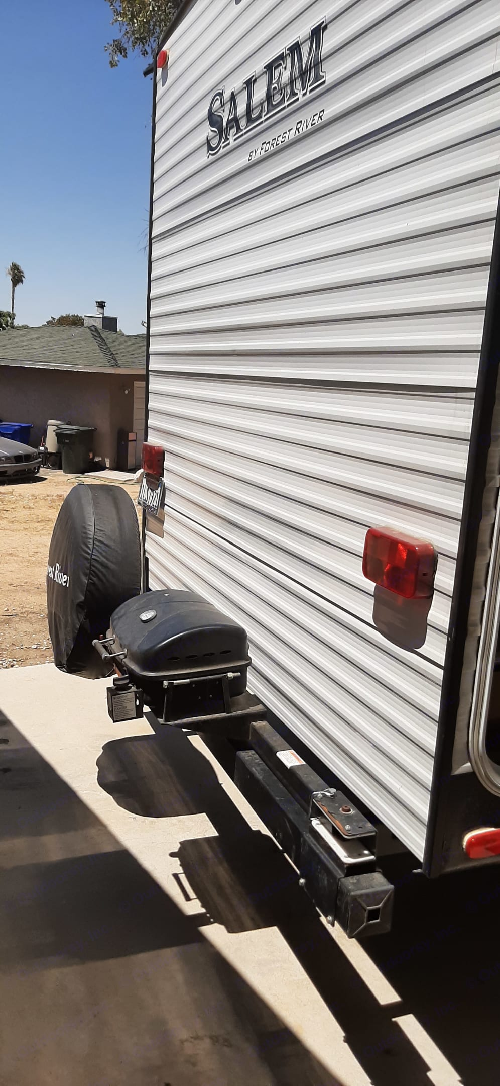 Rear of trailer and mini BBQ gril its gas or charcoal. . Forest River Salem 2017
