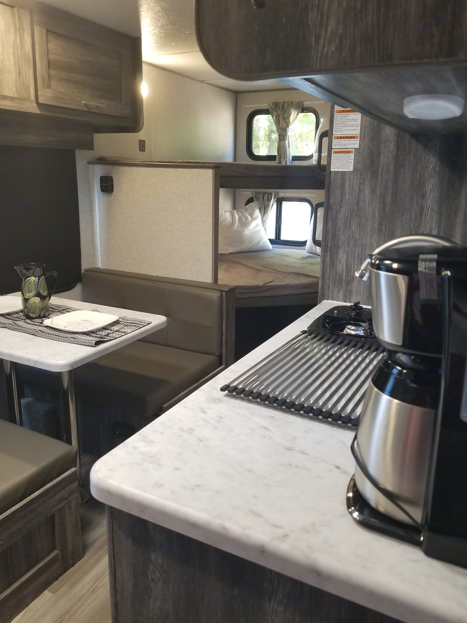 Double bunks with dinette table. Don't forget coffee!. Forest River Wildwood 2020