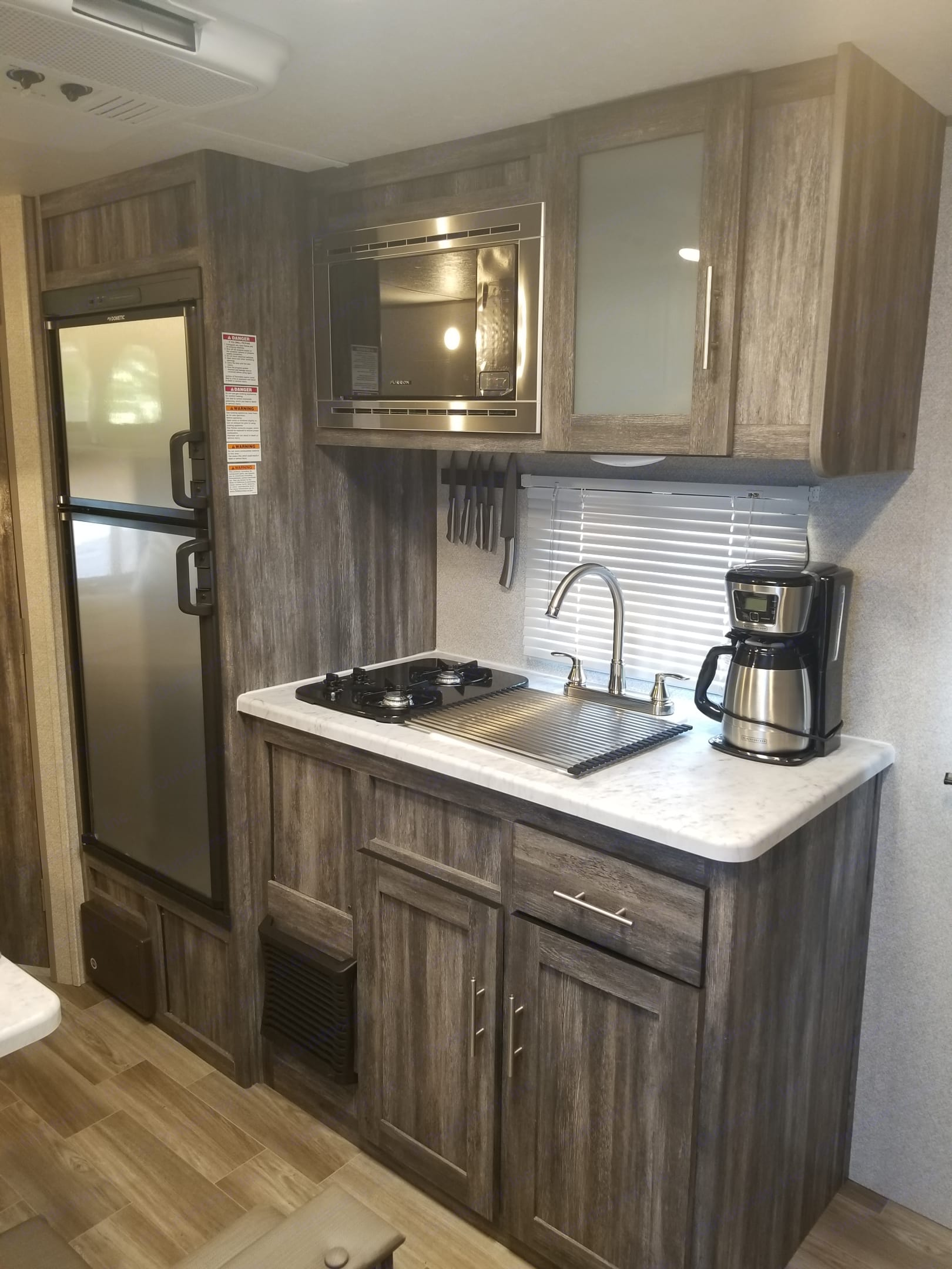 Stove microwave and fridge. Forest River Wildwood 2020