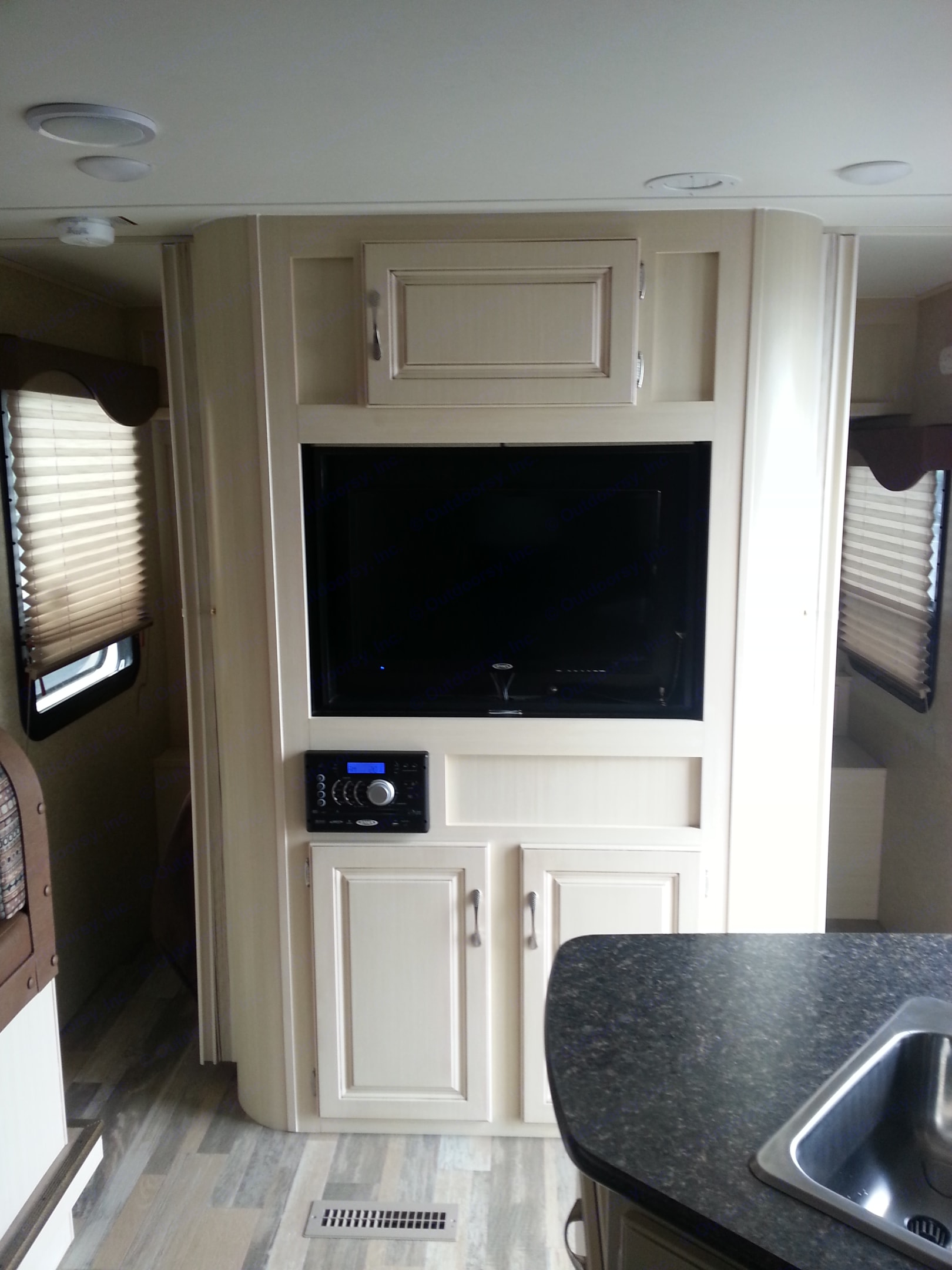 TV turns to face the bed or the living area. Winnebago Minnie 2016