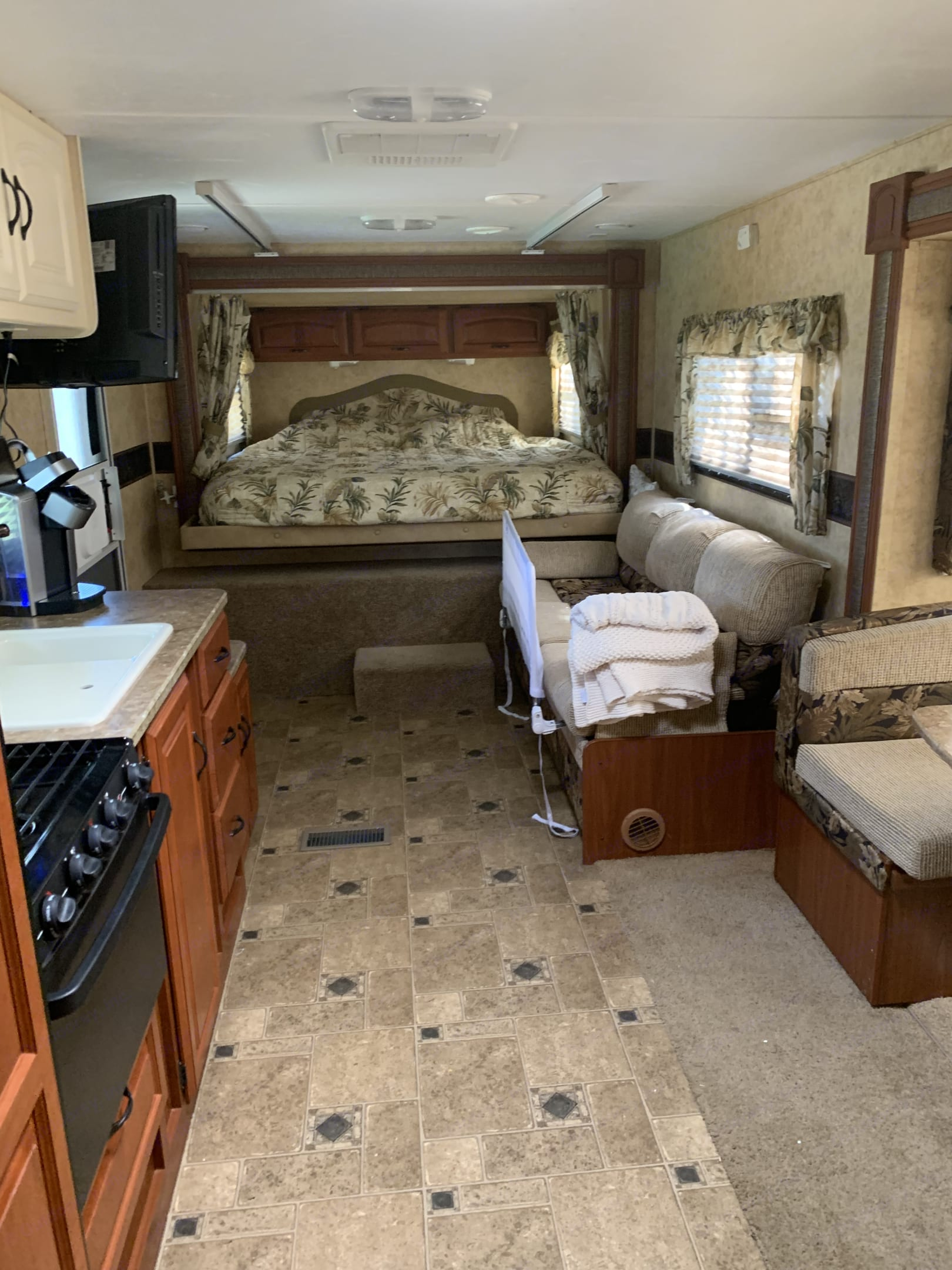 We use the couch for our youngest, the rail is removable and it lays down for a bigger sleeping area. . Keystone Other 2010