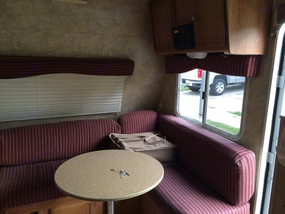 The table can be removed and area pulls out to create an additional bed. . Jayco Jay Feather Sport 2007