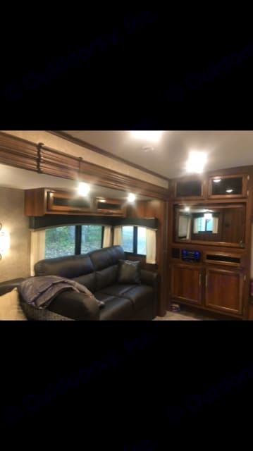 Comfy Couch surrounded by windows the mirror swivel around so you can watch  tv from the couch or bedroom. Jayco Eagle 2016