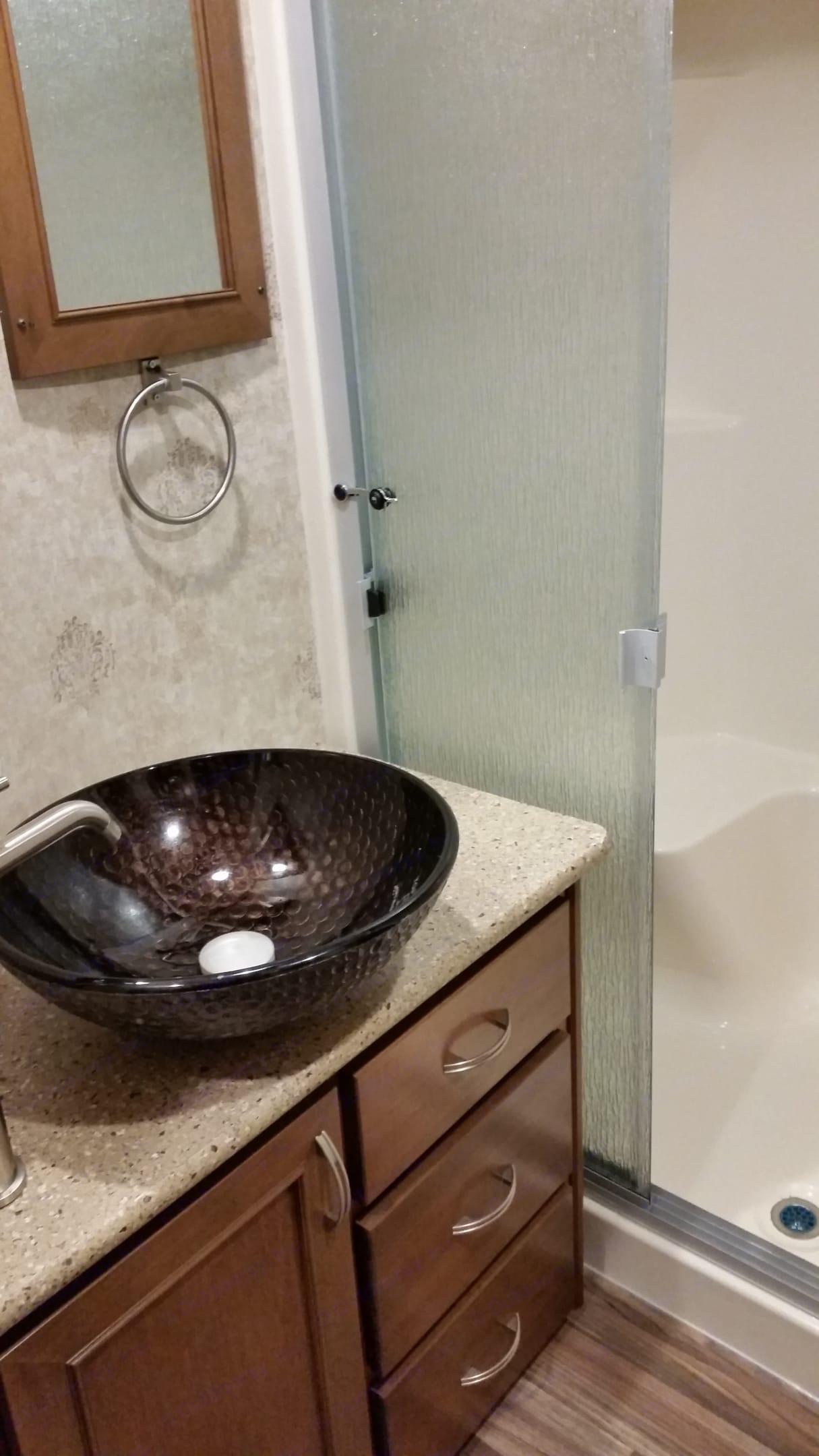 Bathroom sink and partial shower photo. Open Range Roamer 2016