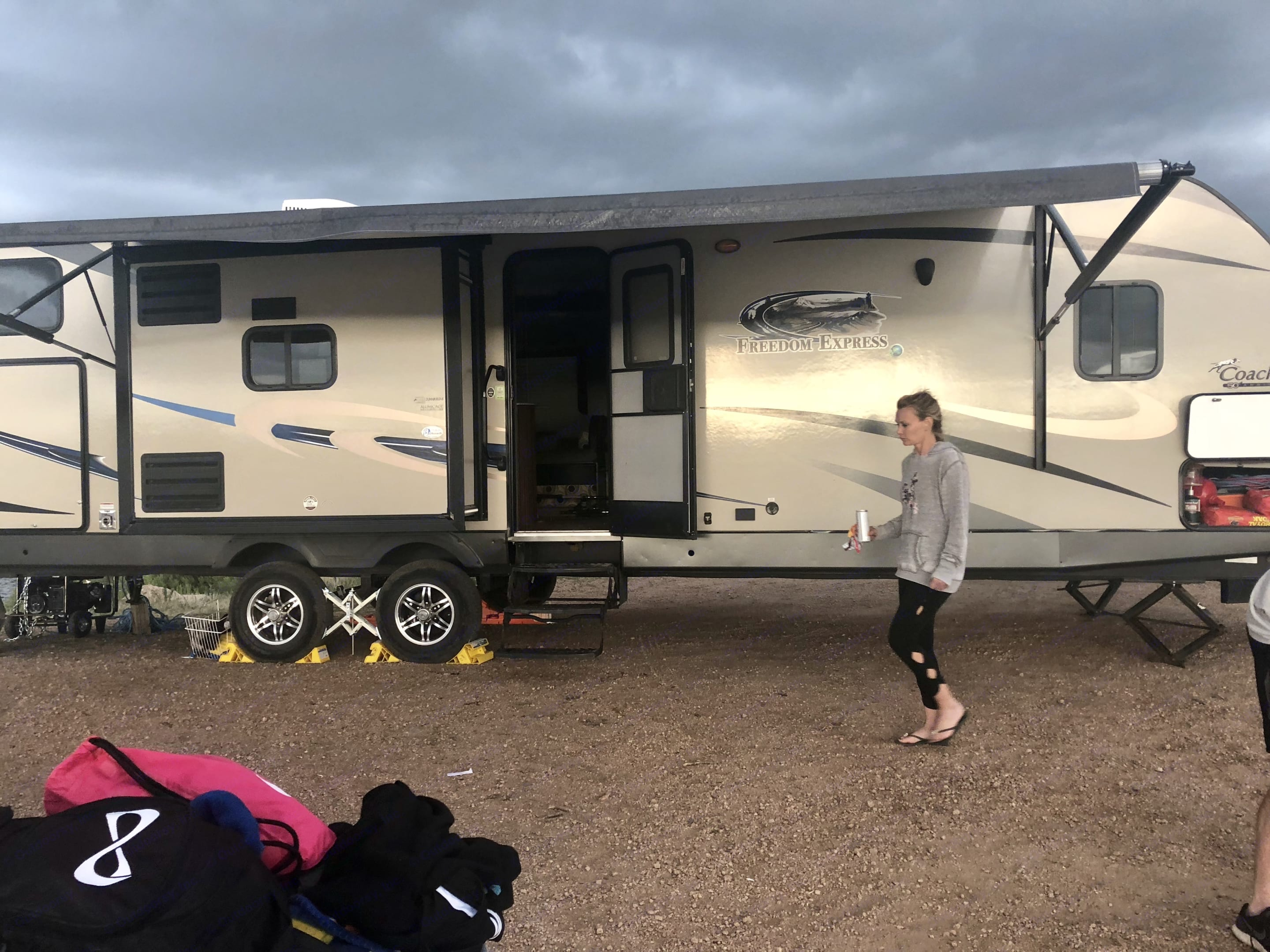 At the lake with the camper . Coachman Freedom express 2014