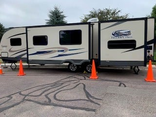 The outside with slide-outs . Coachmen Freedom Express 2014
