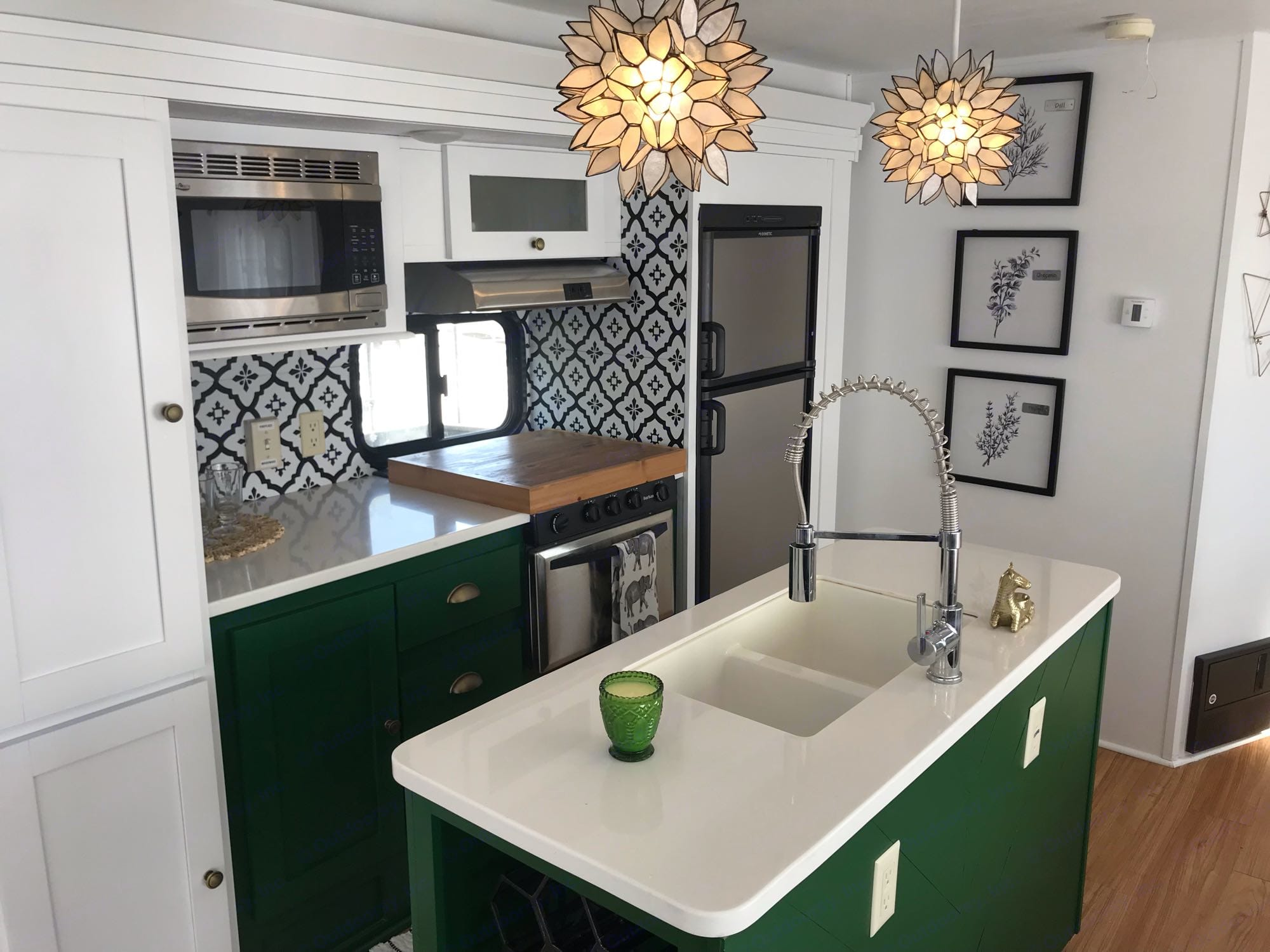 In style green kitchen with shiplap island and solid countertops. The island lights in this space are inspiring.. Forest River Wildwood 2018