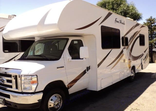 Drivers side exterior. Extended mirrors with close and far view.. Thor Motor Coach Four Winds 2019
