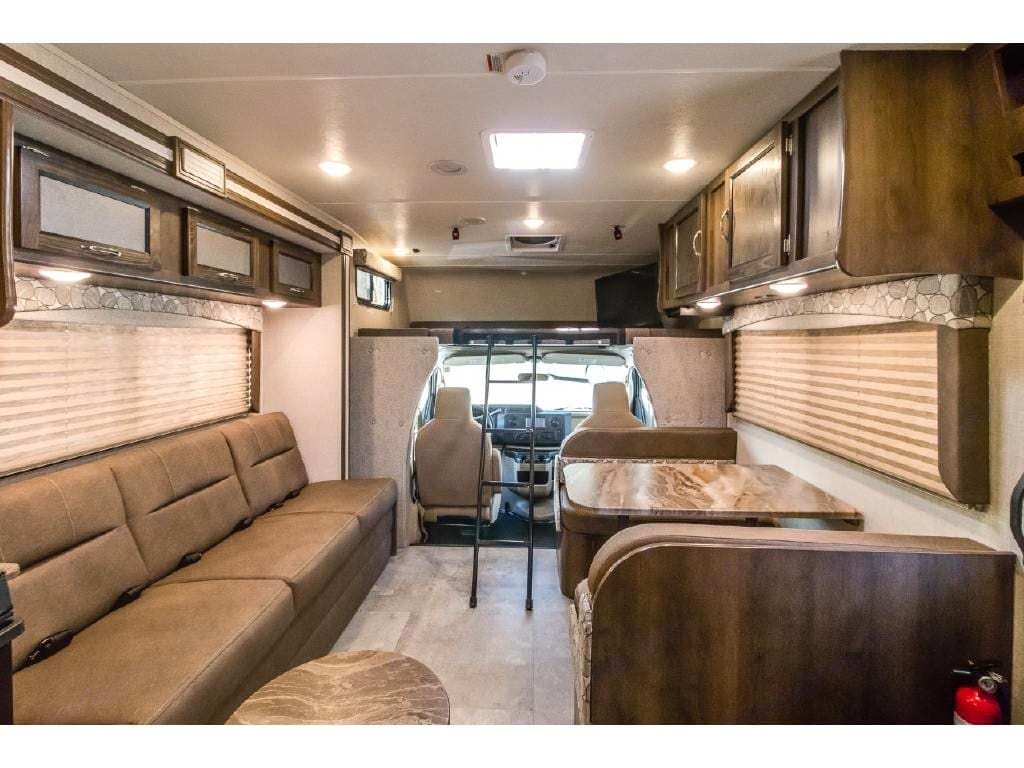 Galley with large over the cab bed and large flat screen TV that swings out to use during your drive.. Coachmen Freelander 2020
